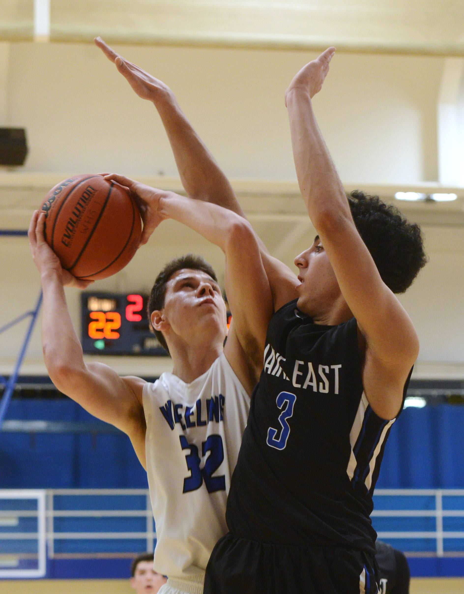 Wheeling's Brandon Zettek, left, drives to the basket against Maine East's Ali Sabet during Tuesday's game at Wheeling.