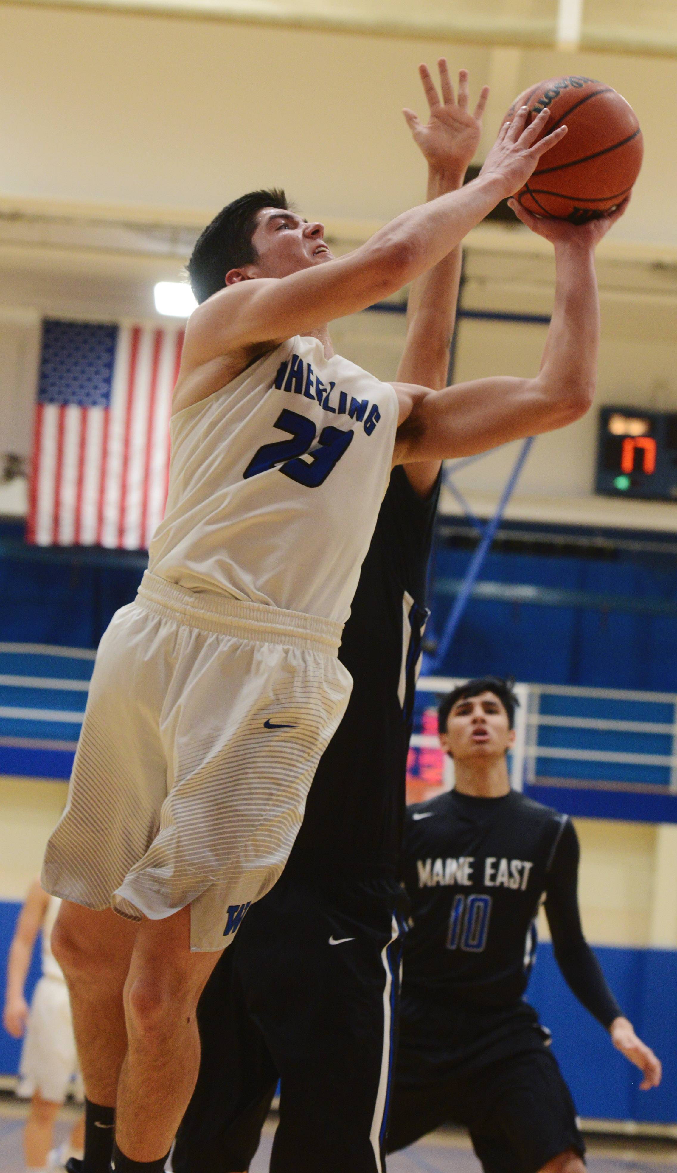 Wheeling's Michael Best makes a strong move to the basket during Tuesday's game against Maine East.
