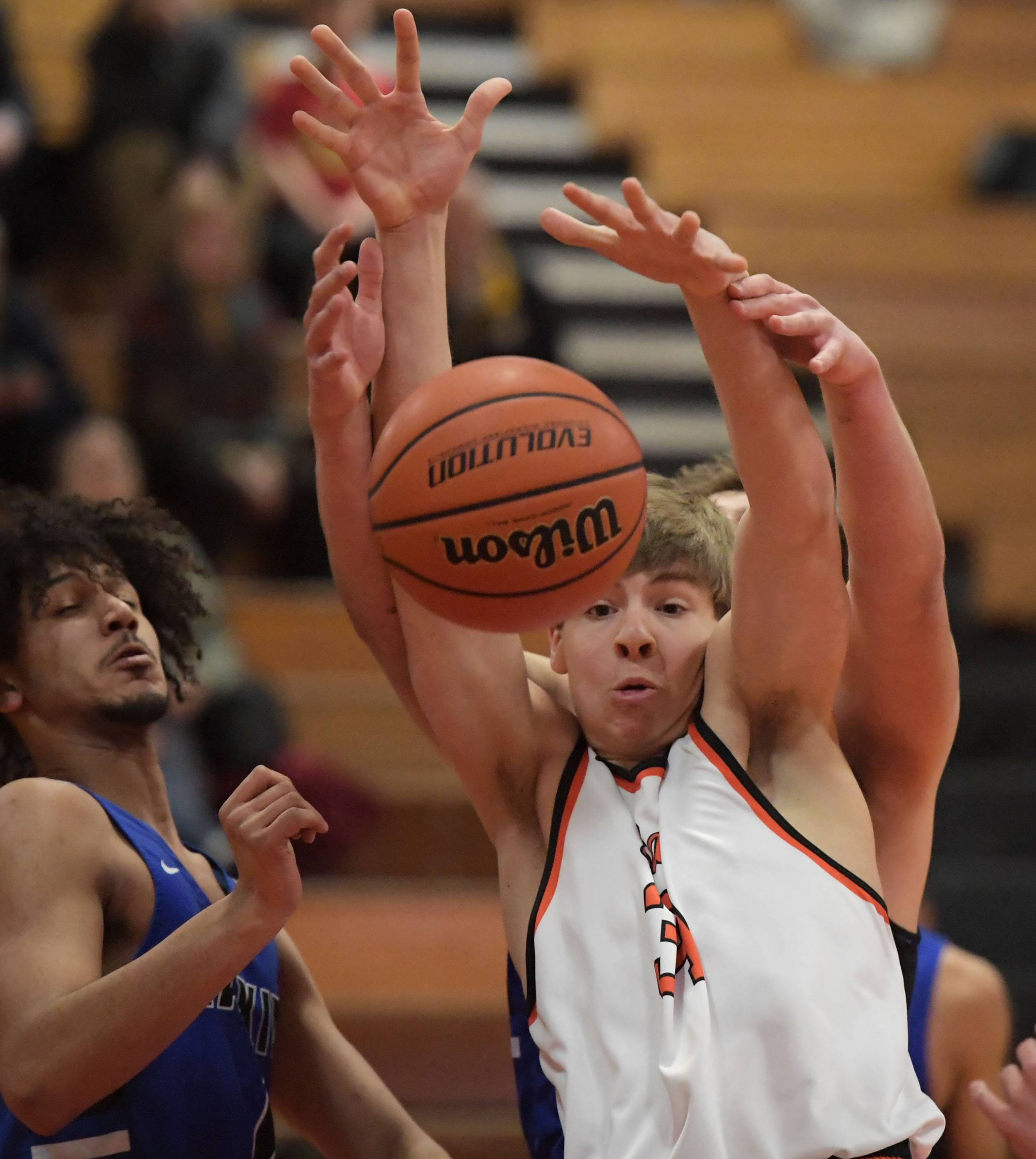 St. Charles East's Aidan Sullivan and Larkin's Max Wiskirchen compete for a rebound Thursday in a boys basketball game in St. Charles.