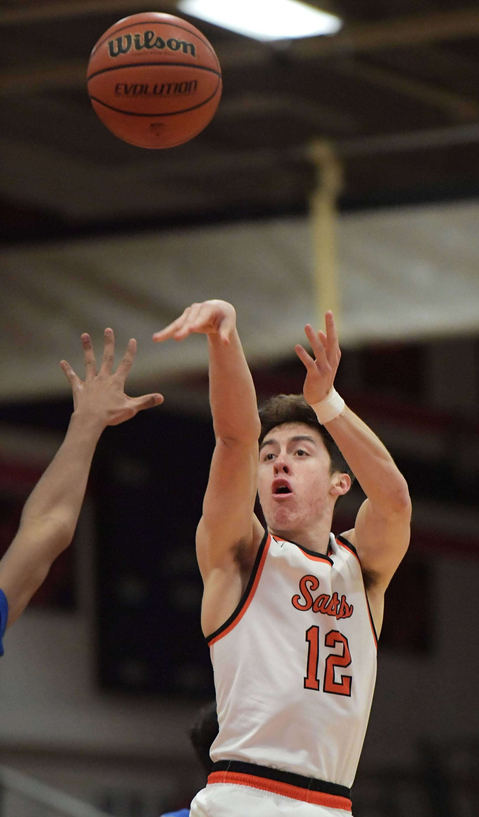 St. Charles East's Nathan Ortiz scores early against Larkin Thursday in a boys basketball game in St. Charles.