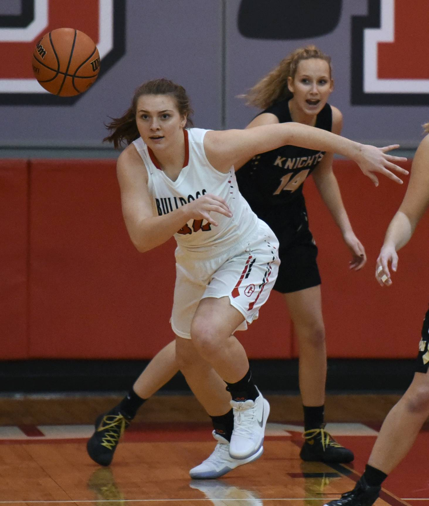 Grant's Mallory Harrity, left, chases down a loose ball as Grayslake North's Abbey Guenther defends during Thanksgiving tournament play at Mundelein. Harrity is pursuing a future as a police detective.