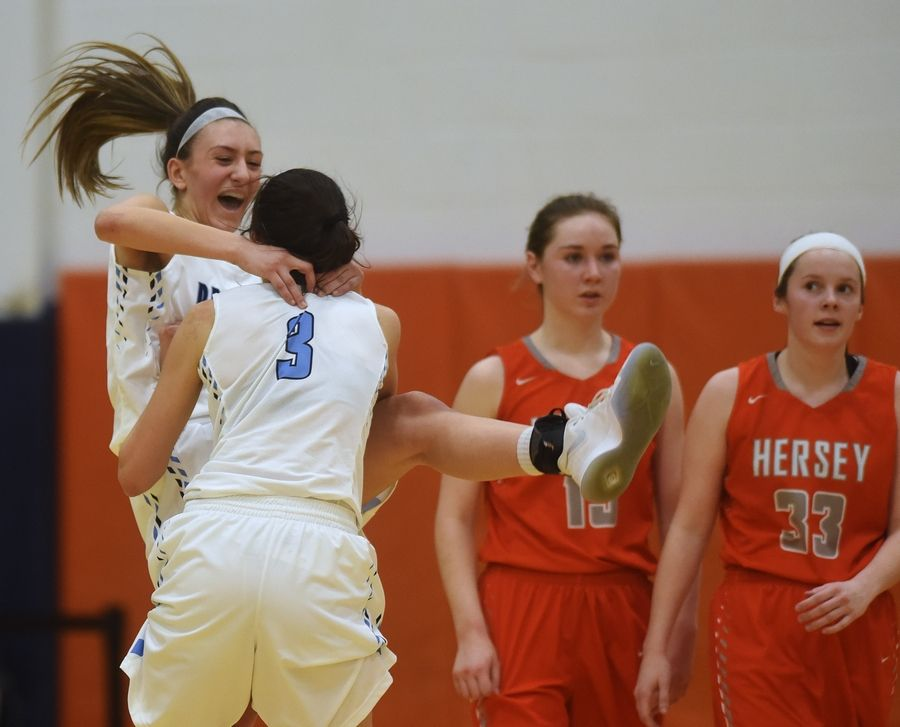 Prospect's Stephanie Kowalczyk, facing, and Emily Frasco celebrate their team's win over Hersey in the Class 4A regional semifinal at Buffalo Grove on Tuesday.