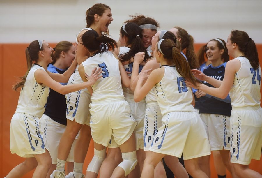 Prospect's players celebrate their victory over Hersey during the Class 4A girls basketball regional semifinal at Buffalo Grove on Tuesday.