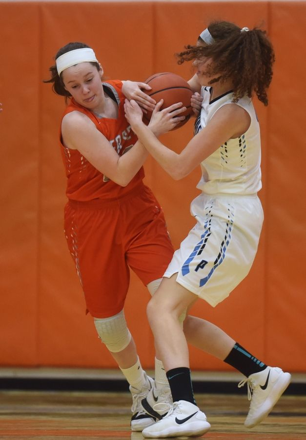 The ball is tied up between Hersey's Mary Kate Fahey, left, and Prospect's Tia Sadlon during the Class 4A girls basketball regional semifinal at Buffalo Grove on Tuesday.