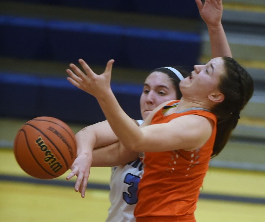 Prospect's Sara Biesterfeldt, left, defends on a drive to the basket by Hersey's Maesyn Benjamin during the Class 4A girls basketball regional semifinal at Buffalo Grove on Tuesday.