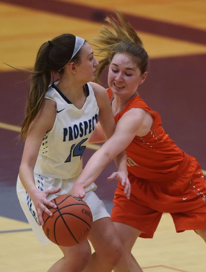Hersey's Emily Collins, right, attempts a steal against Prospect's Stephanie Kowalczyk during the Class 4A girls basketball regional semifinal at Buffalo Grove on Tuesday.
