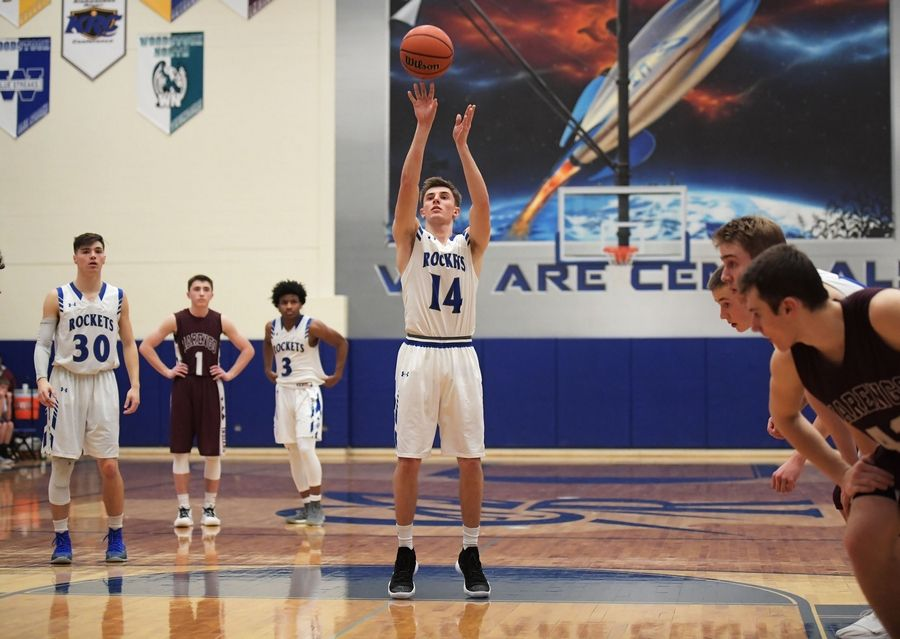 Burlington Central's Zach Schutta ties the school's all-time scoring record with a free throw late in a win against Marengo Tuesday in a boys basketball game in Burlington.