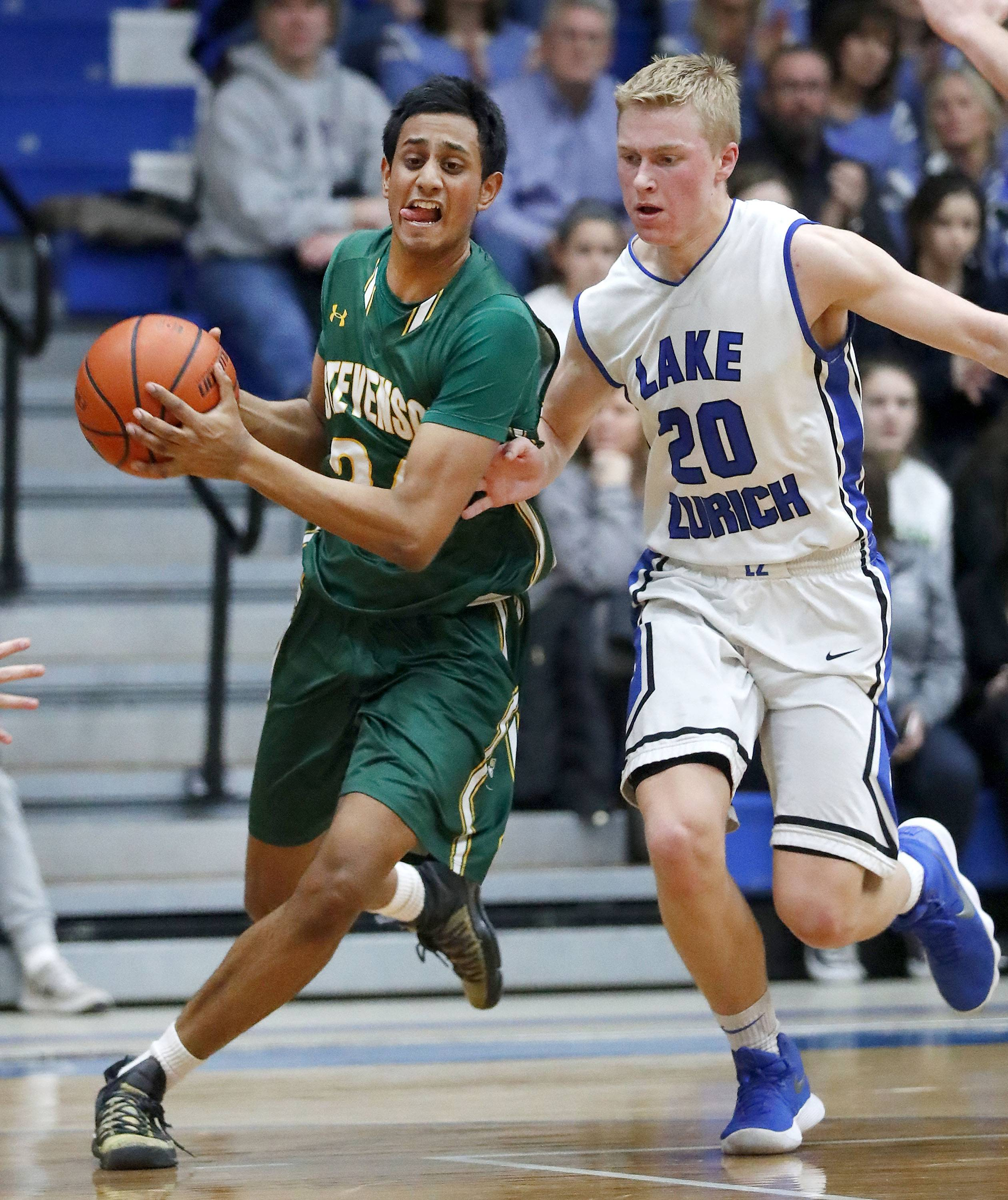 Stevenson's Samvit Ram, left, drives on Lake Zurich's Joe Heffernan on Tuesday night at Lake Zurich.