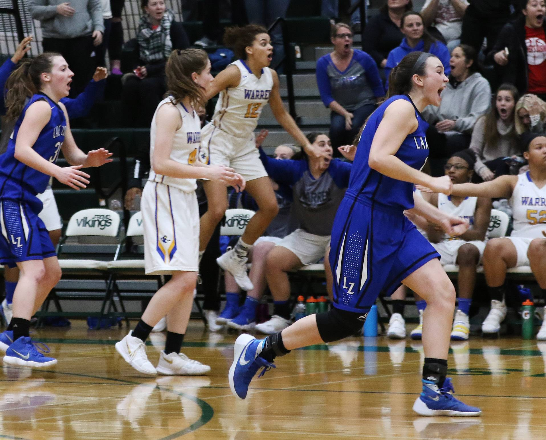 Lake Zurich celebrates as a last-second 3-point attempt by Warren is too late in the championship game of the Fremd sectional on Thursday.