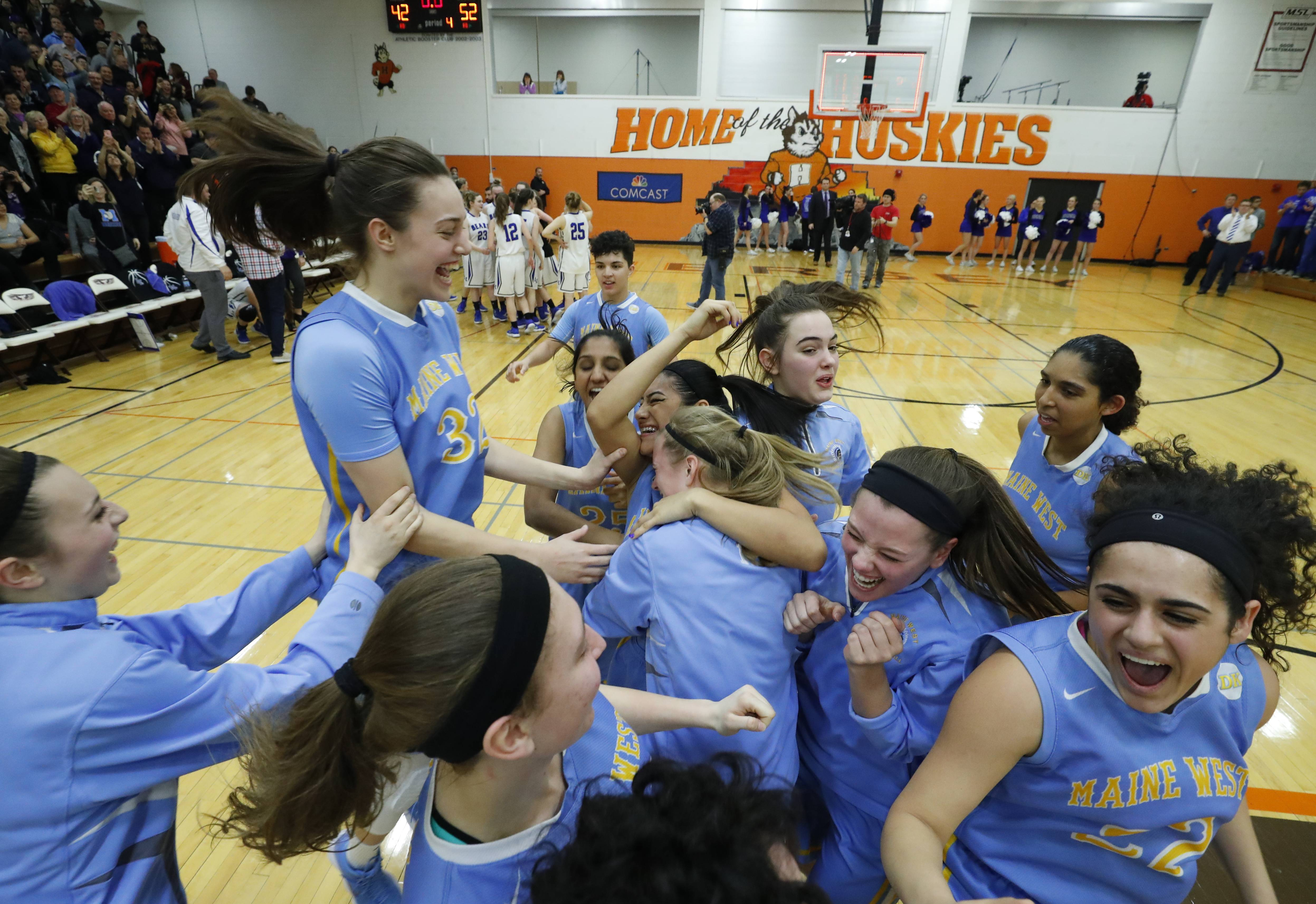 Maine West celebrates after beating Lake Zurich 52-42 in the Class 4A Hersey supersectional in Arlington Heights on Monday.