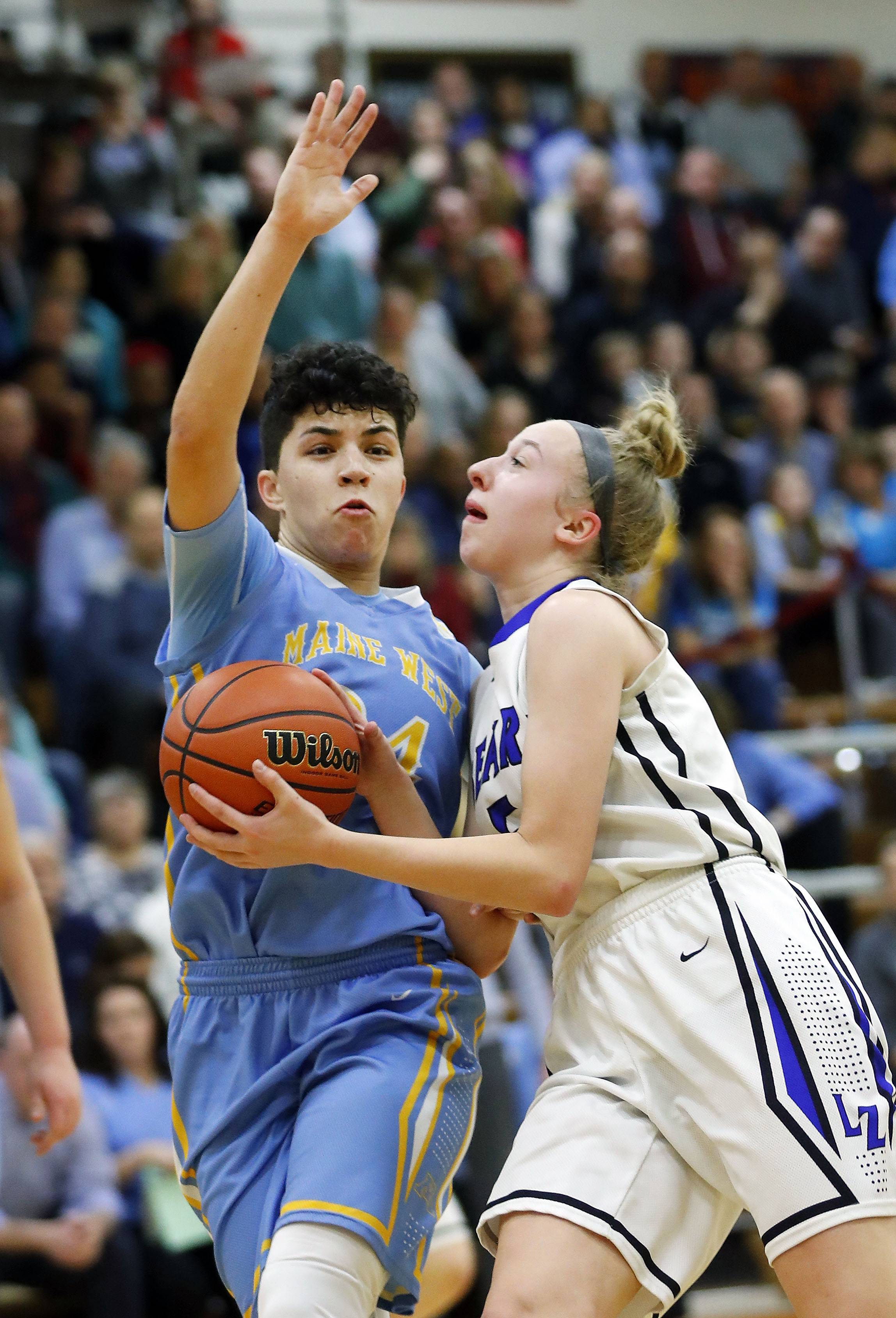 Lake Zurich's Ella Gilbertson, right, drives on Maine West's Alisa Fallon during the Class 4A Hersey supersectional in Arlington Heights on Monday.