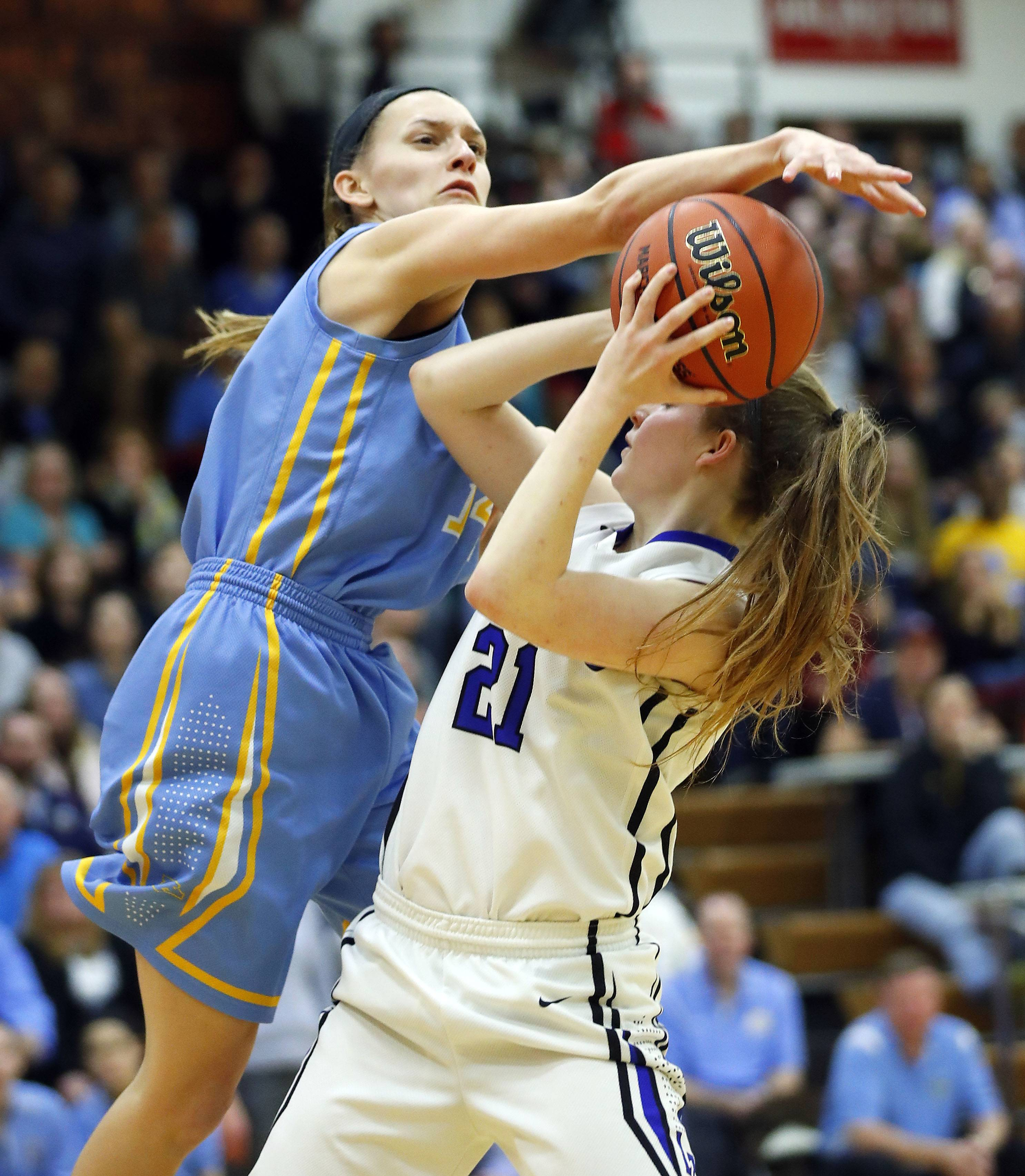 Maine West's Catherine Johnson, left, defends against Lake Zurich's Anna Biergans during the Class 4A Hersey supersectional in Arlington Heights on Monday.