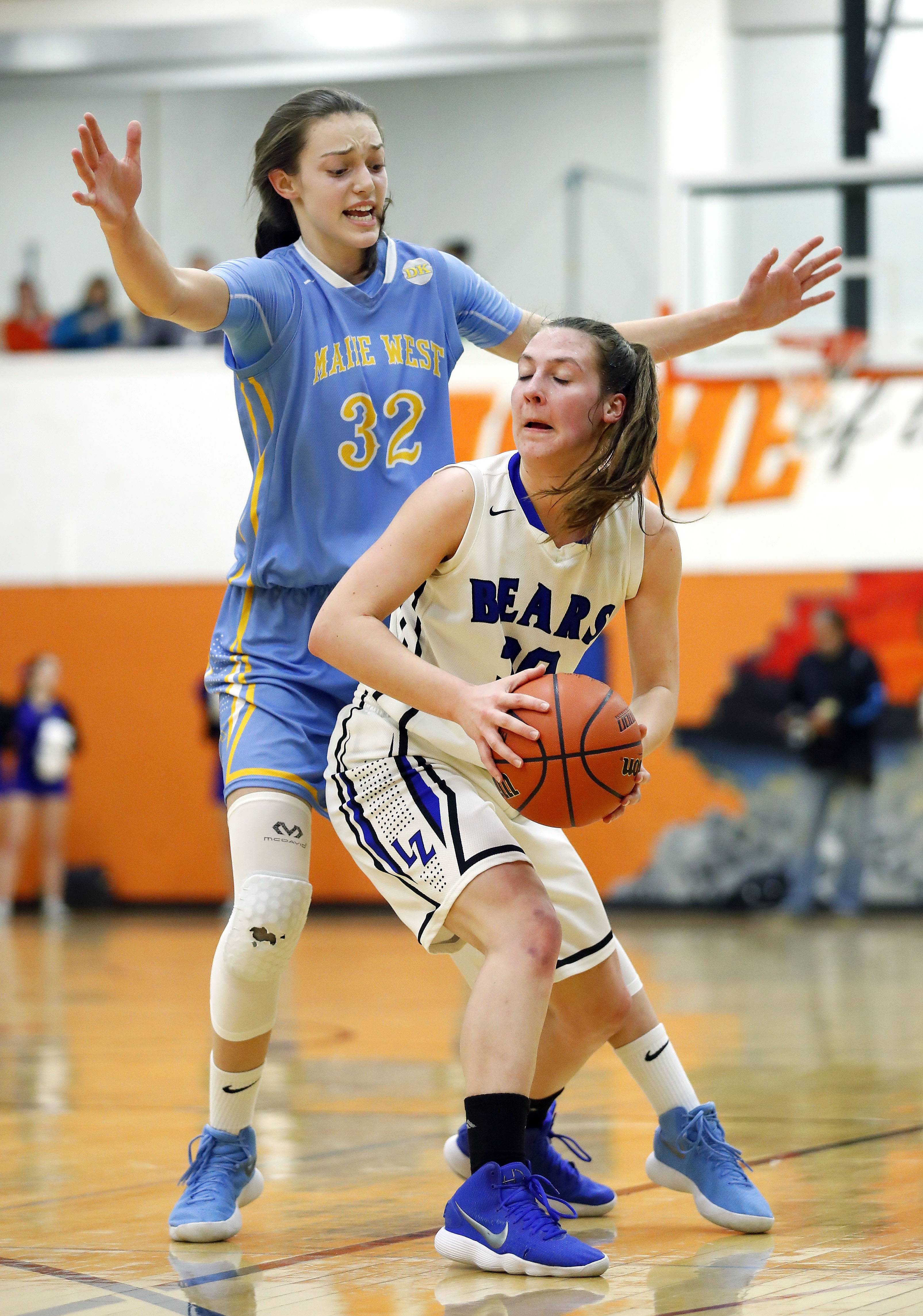 Maine West's Angela Dugalic (32) defends against Lake Zurich's Grace Kinsey during the Class 4A Hersey supersectional in Arlington Heights on Monday.