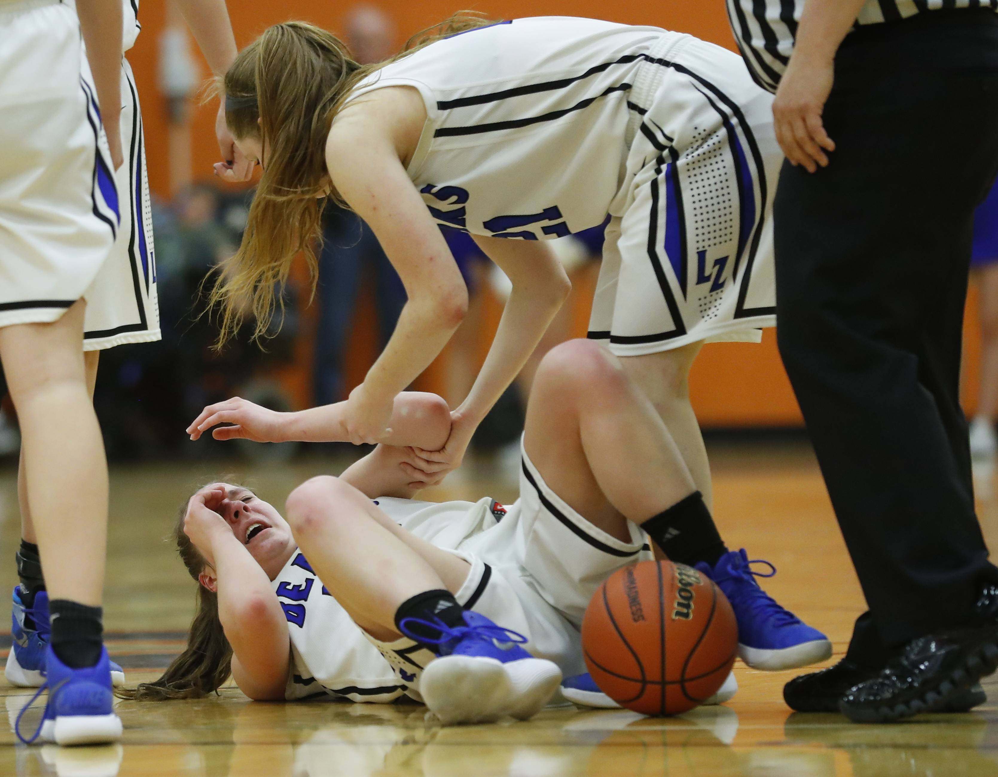 Lake Zurich's Grace Kinsey lays on the ground after some rough play during the Class 4A supersectional at Hersey High School in Arlington Heights on Monday.