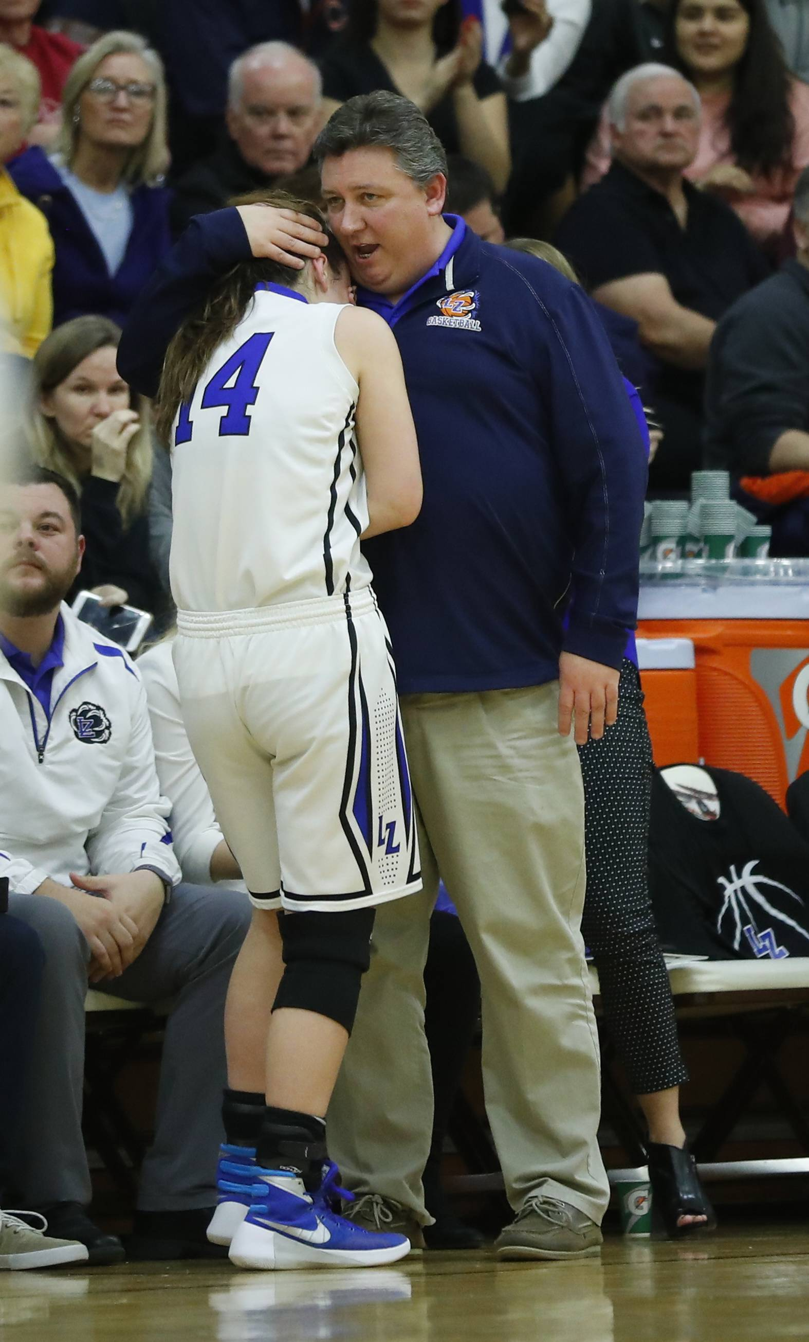 Lake Zurich's McKenna Zobel is consoled by coach Chris Bennett during the Class 4A supersectional at Hersey High School in Arlington Heights on Monday.