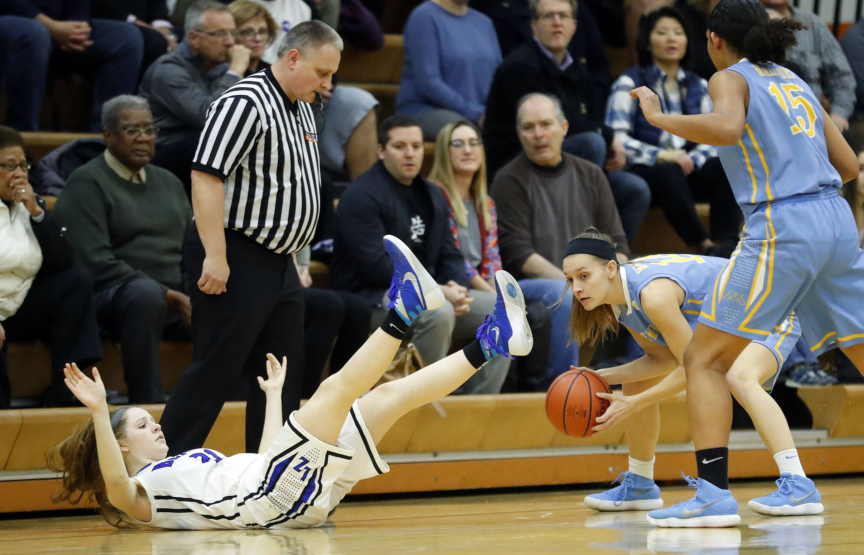 Maine West's Catherine Johnson, right, steals the ball from Lake Zurich's Anna Biergans during the Class 4A Hersey supersectional in Arlington Heights on Monday.