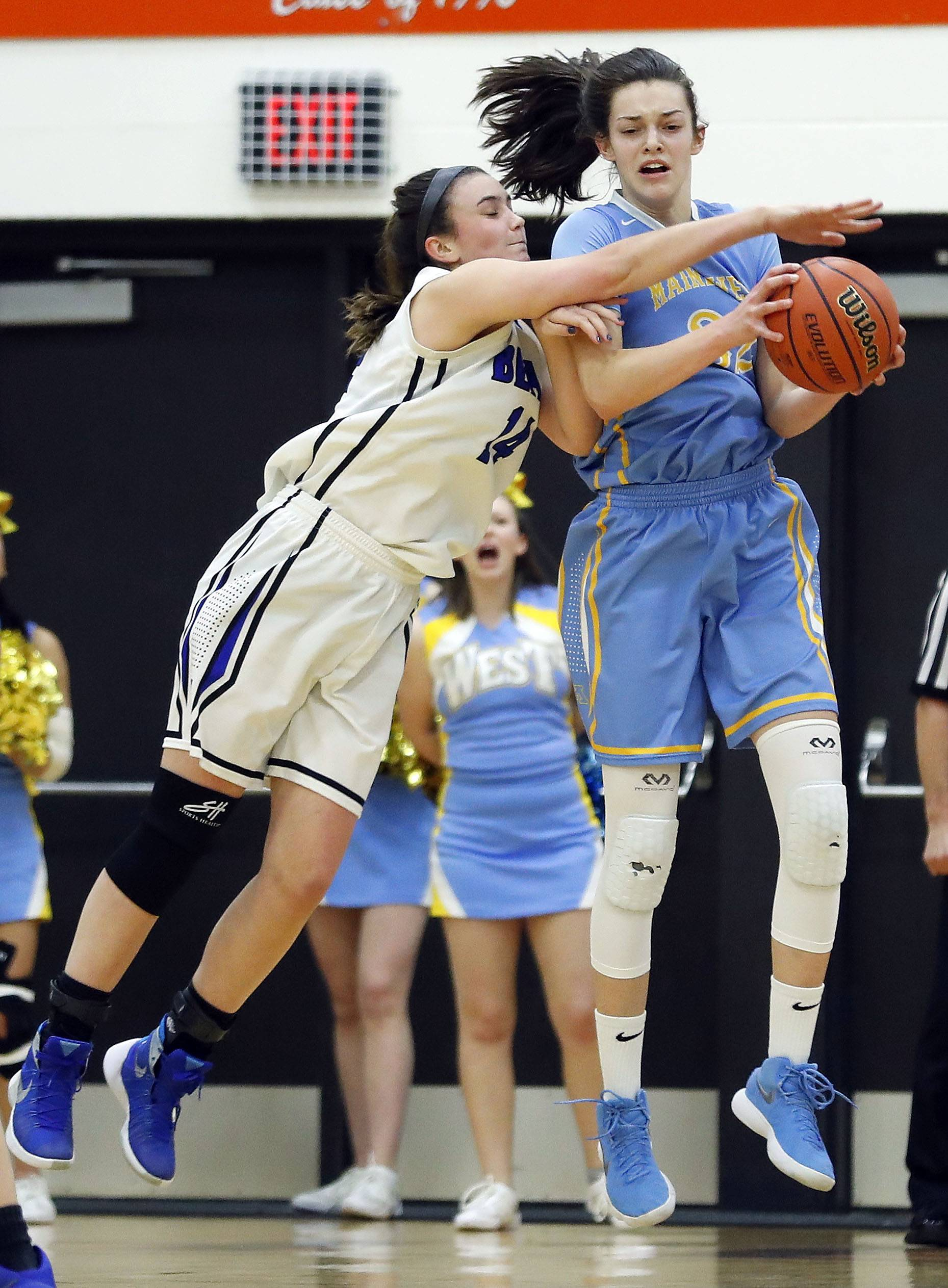 Maine West's Angela Dugalic, right, and Lake Zurich's McKenna Zobel battle for a rebound during the Class 4A Hersey supersectional in Arlington Heights on Monday.