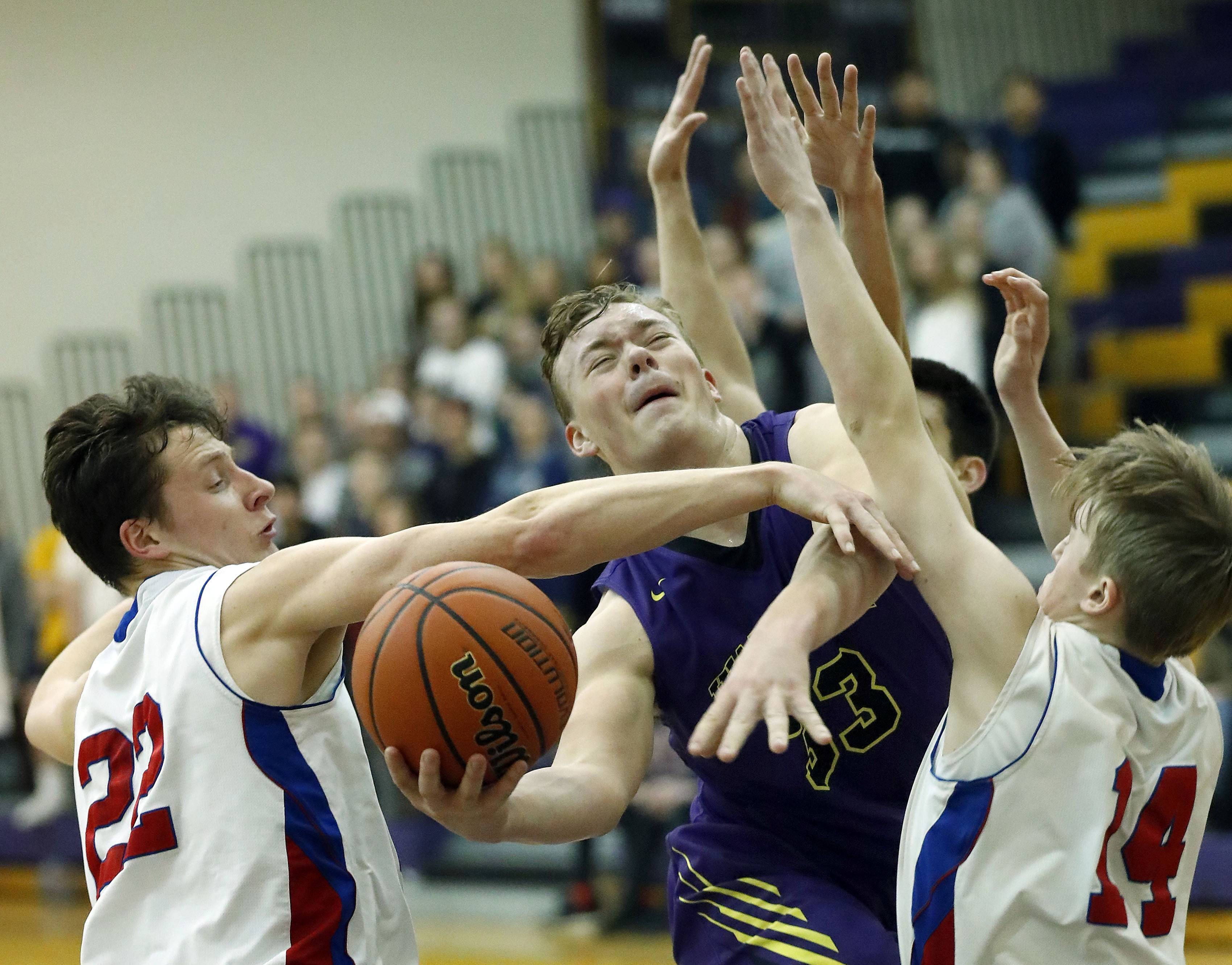 Wauconda's Andrew Nolan, middle, drives on Lakes' Logan McCann (22) and Chance Andell during Class 3A regional semifinal play Tuesday at Wauconda.