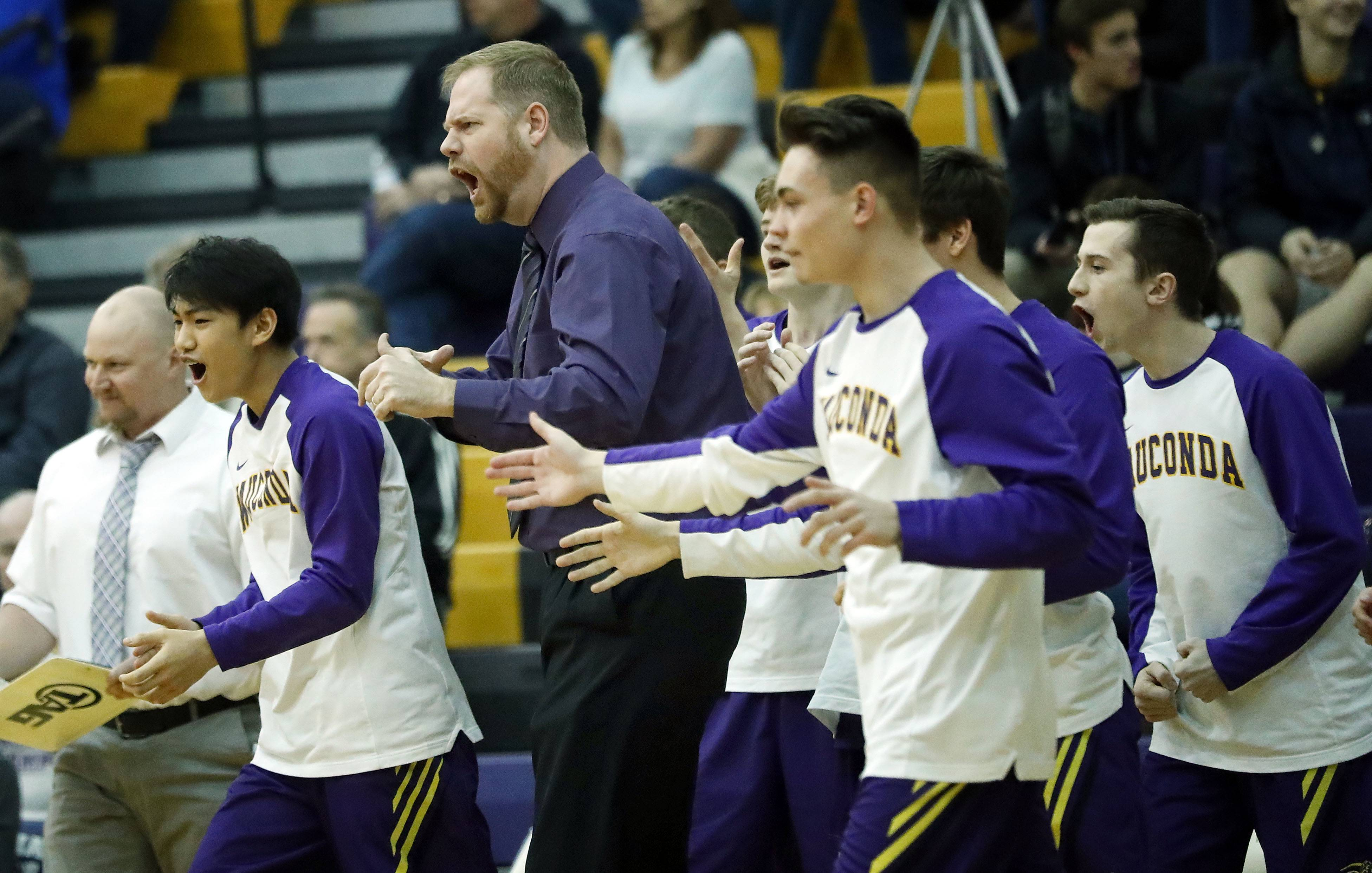 Wauconda coach Scott Luetschwager and the bench cheer on Tuesday against Lakes.