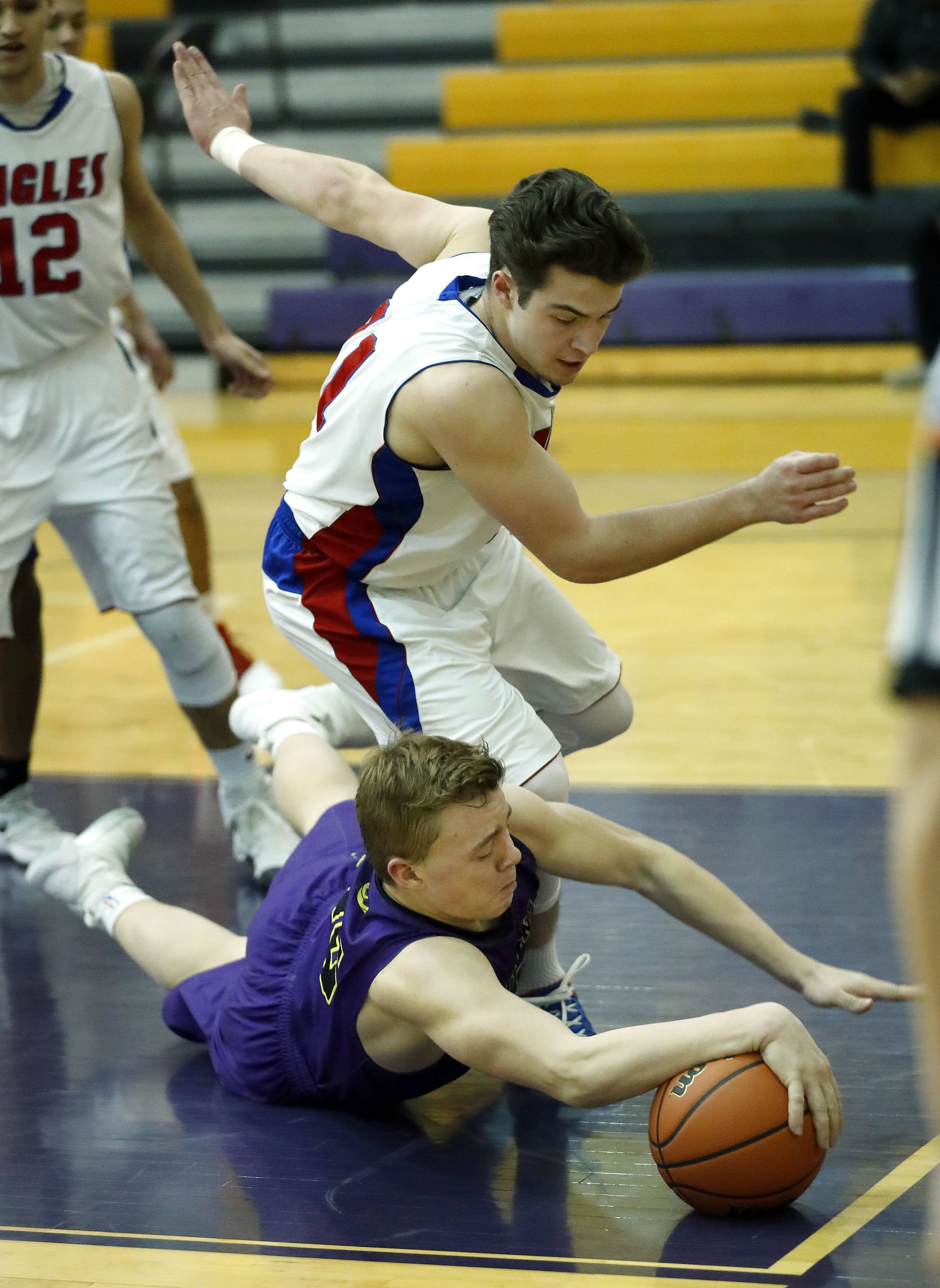 Wauconda's Andrew Nolan, bottom, and Lakes' Michael Behrendt scramble for a loose ball during Class 3A regional semifinal play Tuesday at Wauconda.