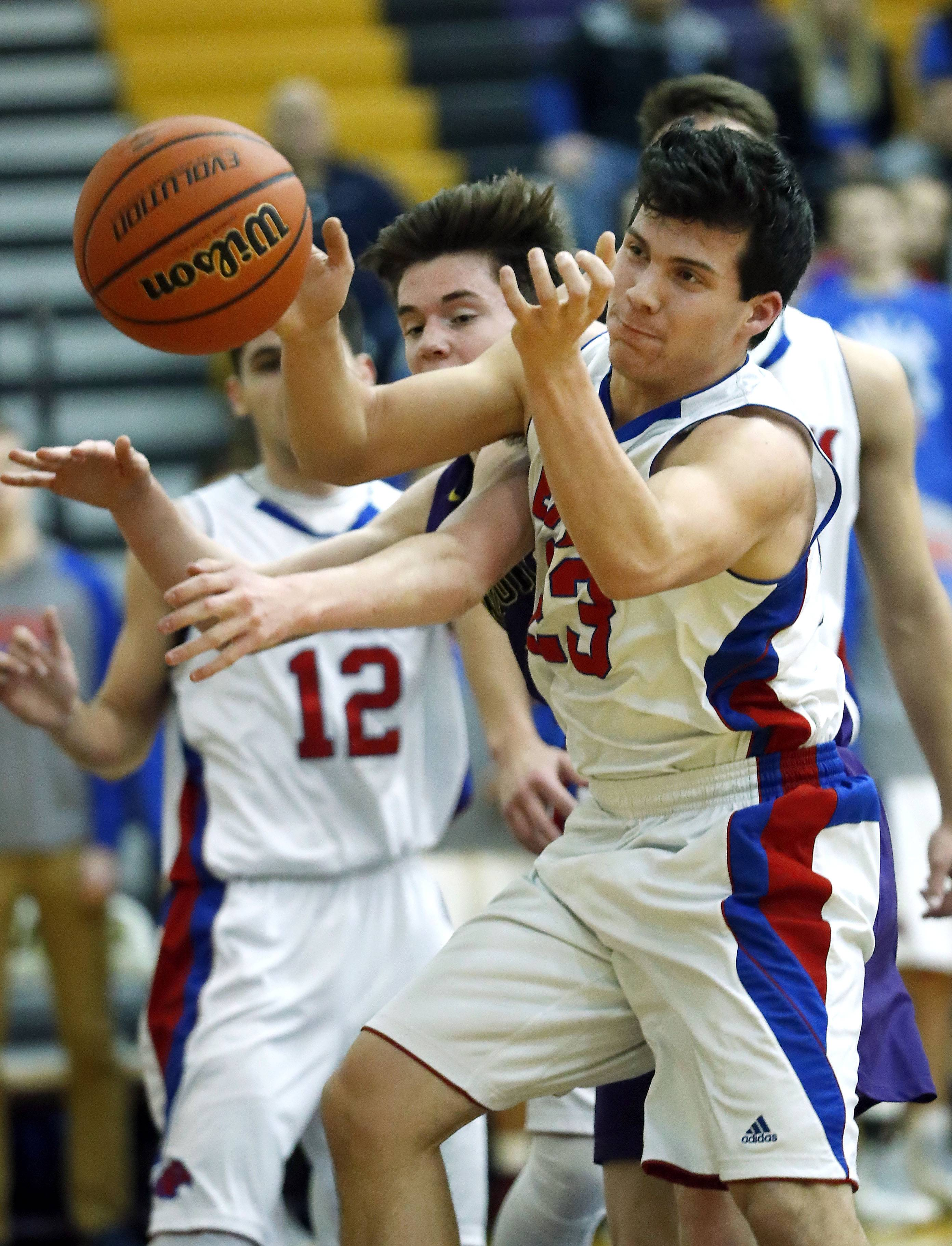 Lakes' Ethan Greenfield, right, fights for a rebound with Wauconda's Nick Bulgarelli.
