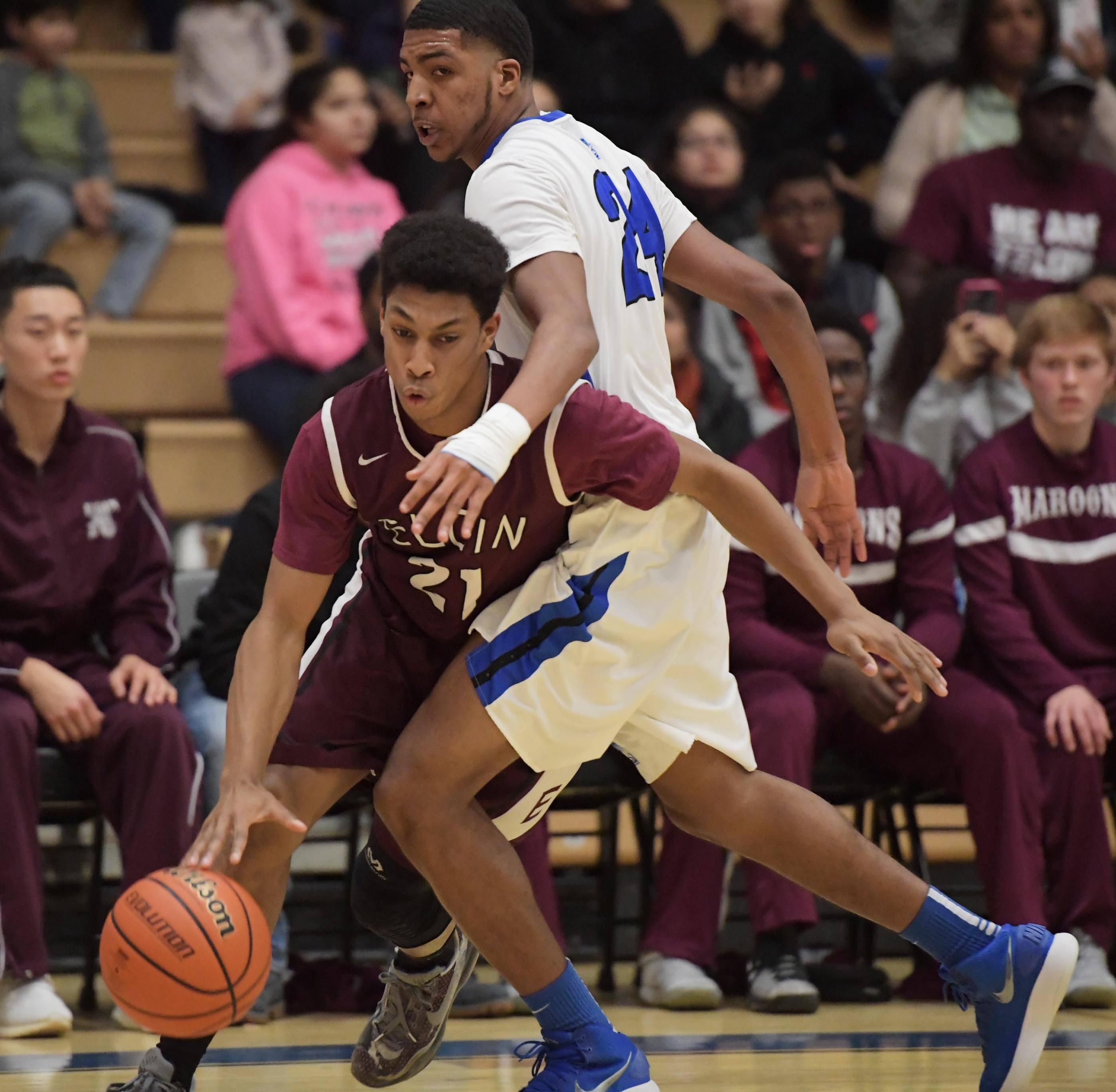 Elgin's Michael Weatherburn gets around Larkin's Isaiah Talley Tuesday in the St. Charles North boys basketball regional game.