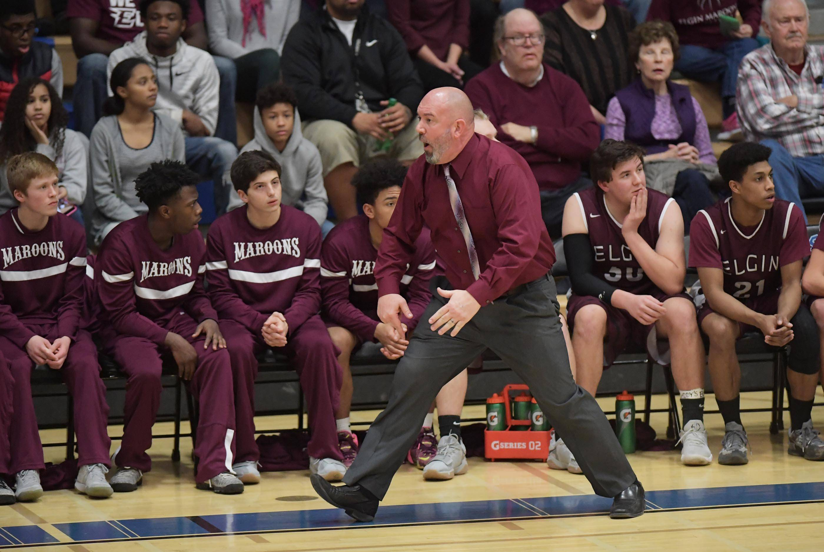 Elgin head coach Mike Sitter reacts to a call Tuesday in the St. Charles North boys basketball regional game against Larkin. It was his final basketball game as he will be the new athletic director at Hampshire High School next school year.