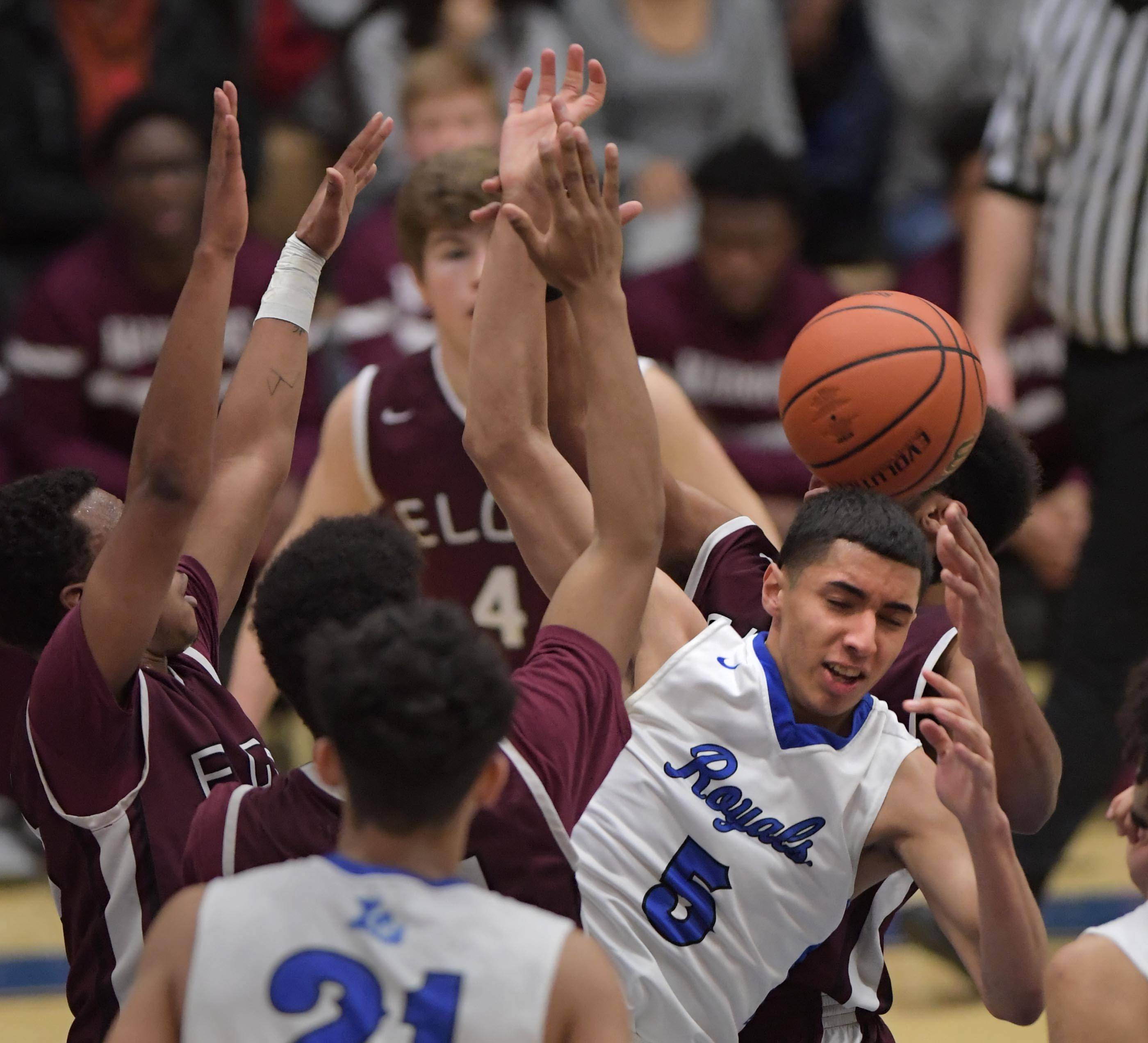 Larkin's Victor Perez loses the ball in a crowd of Elgin defenders Tuesday in the St. Charles North boys basketball regional game.