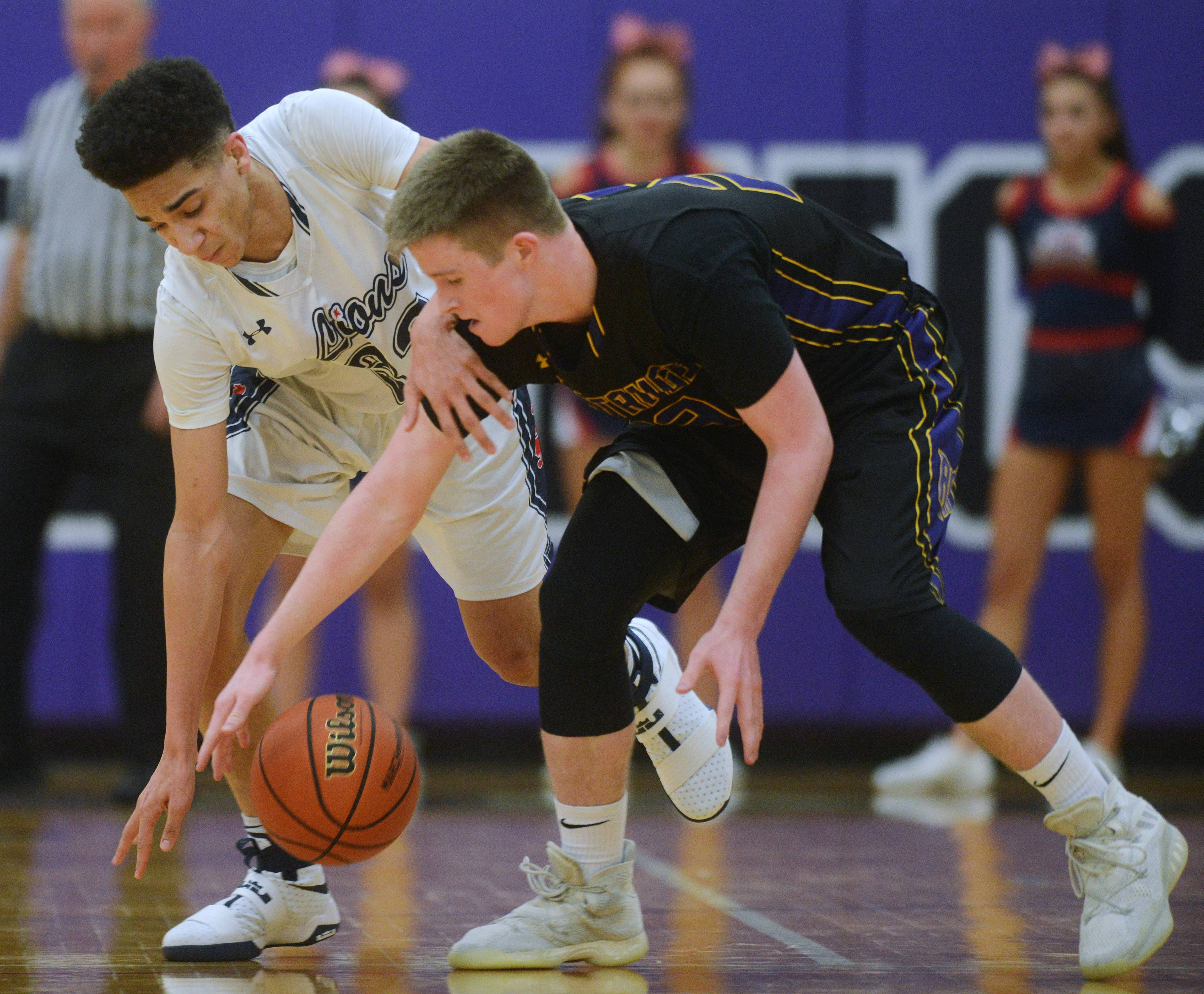 St. Viator's Jeremiah Hernandez, left, steals the ball from Rolling Meadows' Joe Coen during regional semifinal play at Niles North in Skokie on Wednesday.