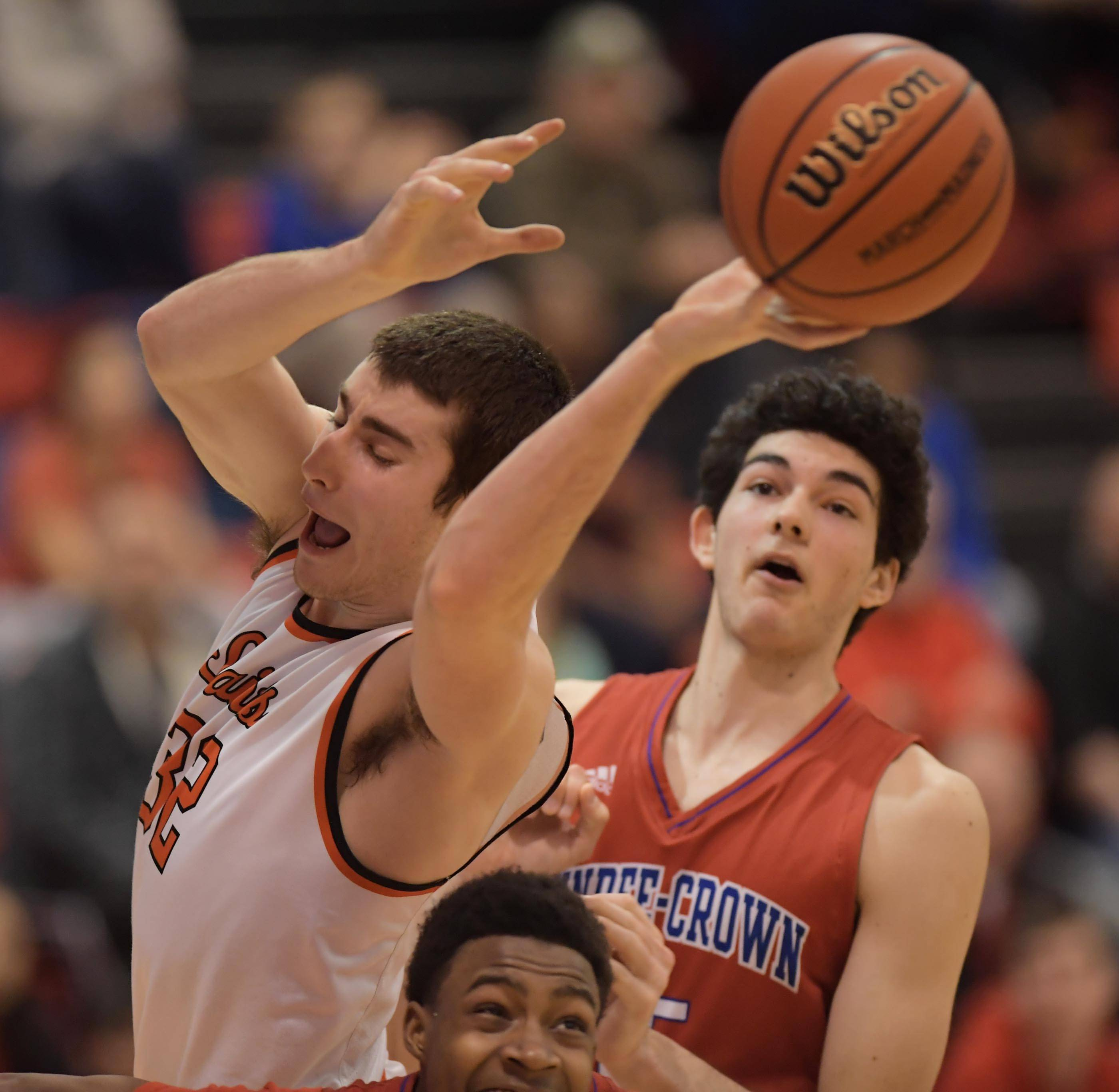 St. Charles East's Justin Hardy loses the ball around Dundee-Crown's Damarion Butler and Gabriel Bergeron in the Class 4A Dundee-Crown boys basketball semifinal regional game Wednesday.