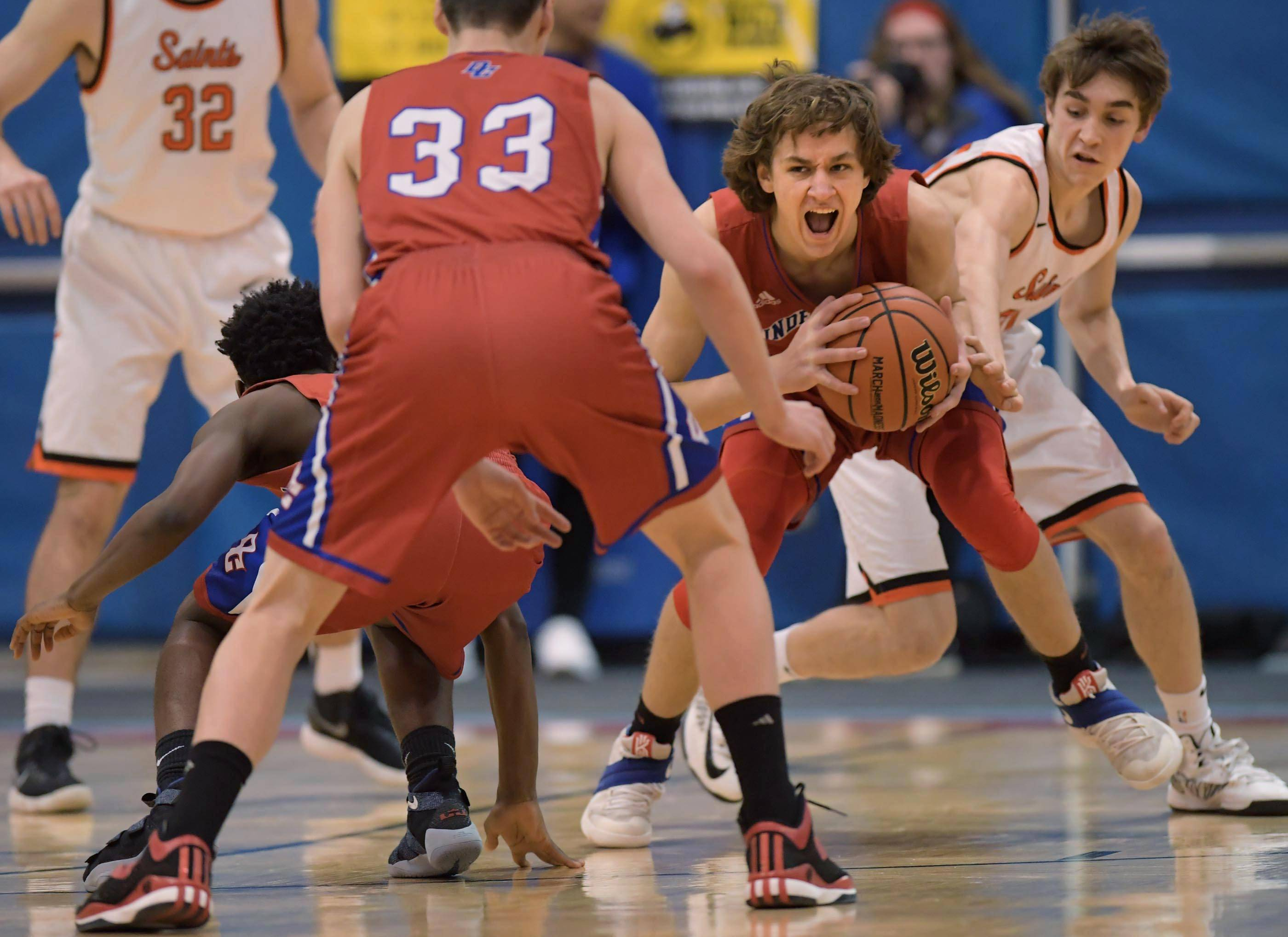 Dundee-Crown's Josh Raby comes up with a loose ball against St. Charles East in the Class 4A Dundee-Crown boys basketball semifinal regional game Wednesday.