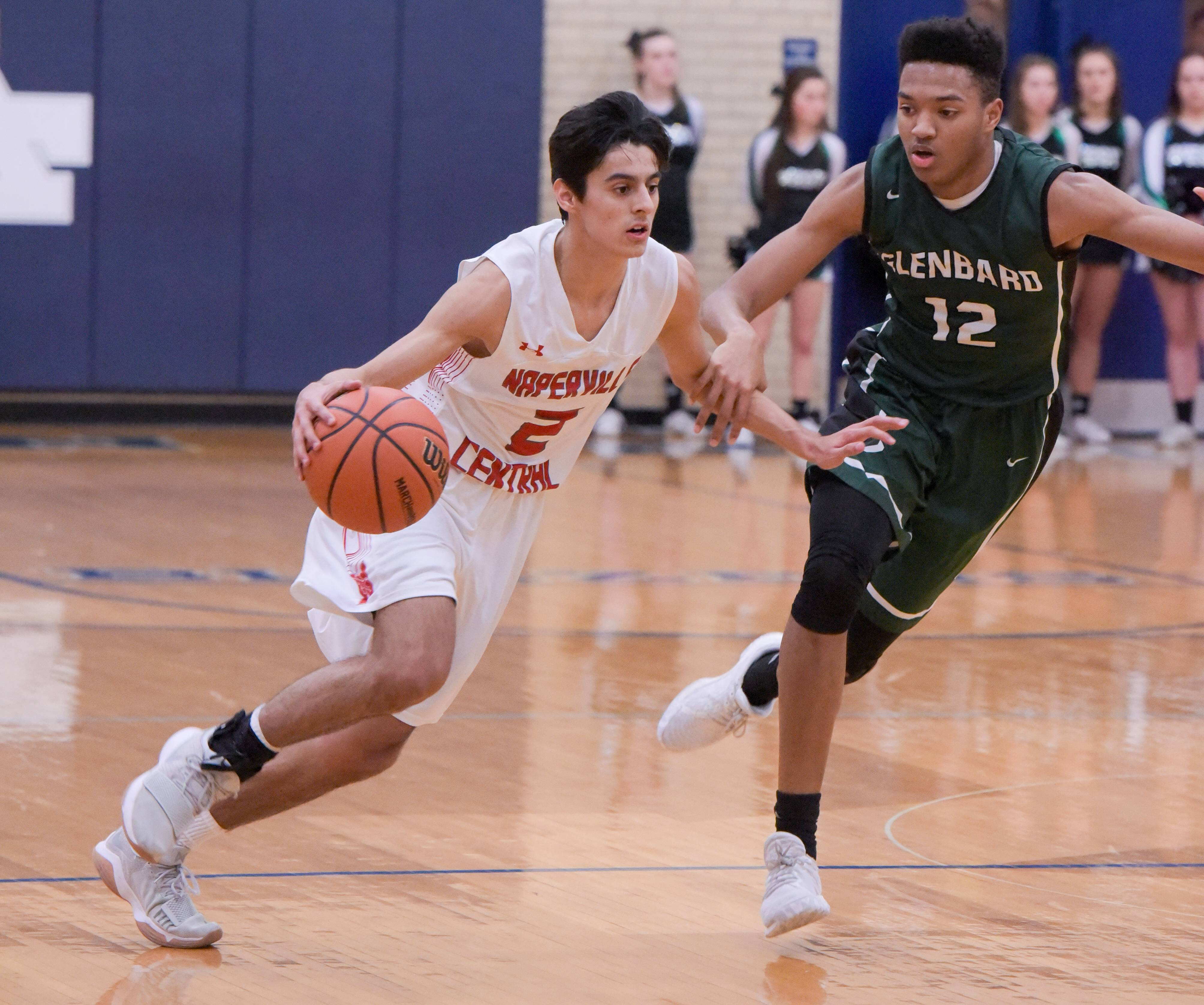 Naperville Central's Tyler O'Brien (2) drives past Glenbard West's Evan Taylor (12) during the boys Class 4A regional semifinals basketball game at Addison Trail on February 28, 2018.