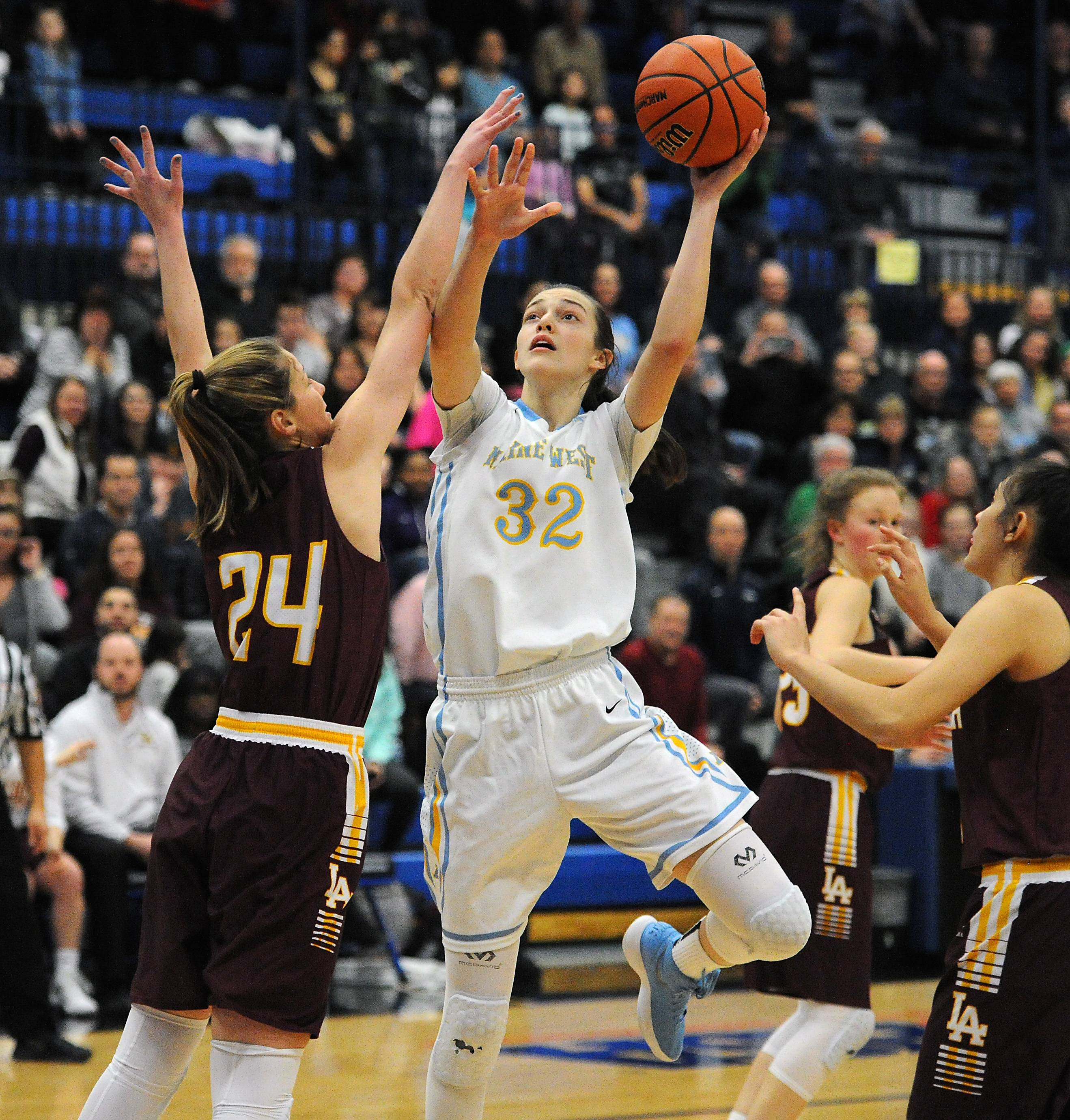 Maine West and Angela Dugalic (32) hope to prevent Geneva from advancing to the state championship game when the Warriors meet the Vikings in a Class 4A semifinal Friday at Redbird Arena in Normal.