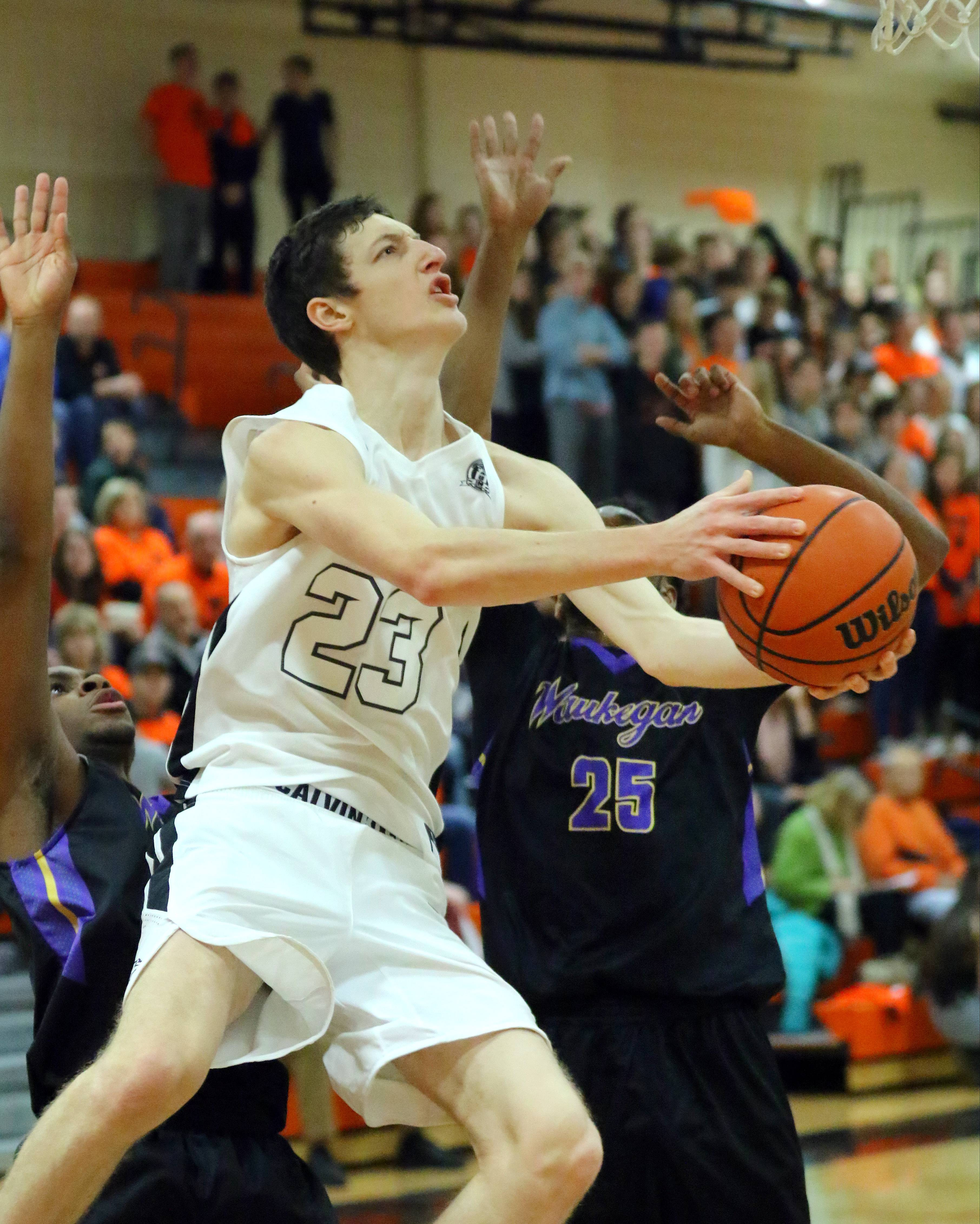 Libertyville's senior Drew Peterson, here driving against Waukegan, leads the Wildcats into Class 4A regional final play against Conant on Friday at Deerfield.