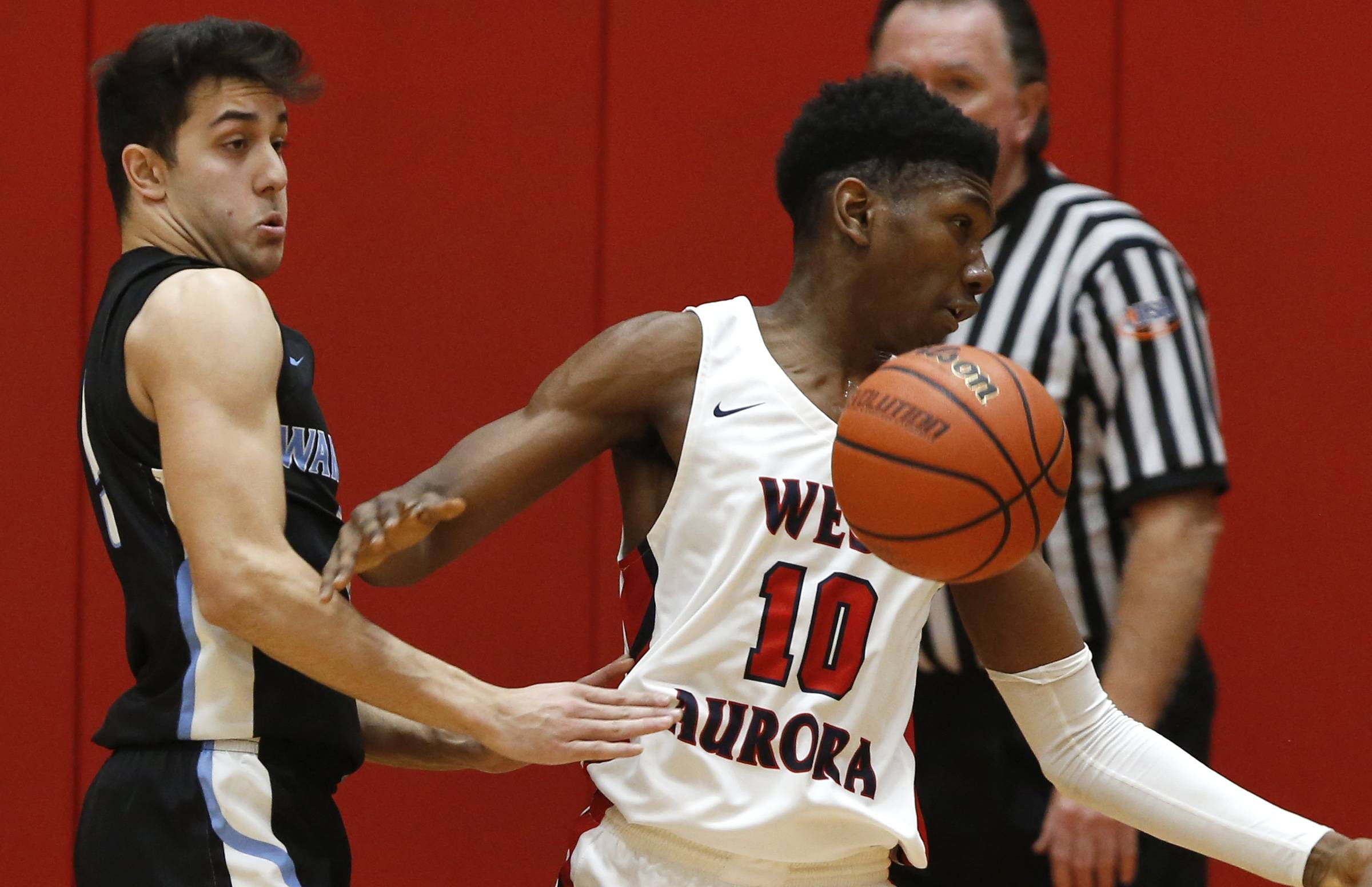 West Aurora's Crutcher soars to new heights