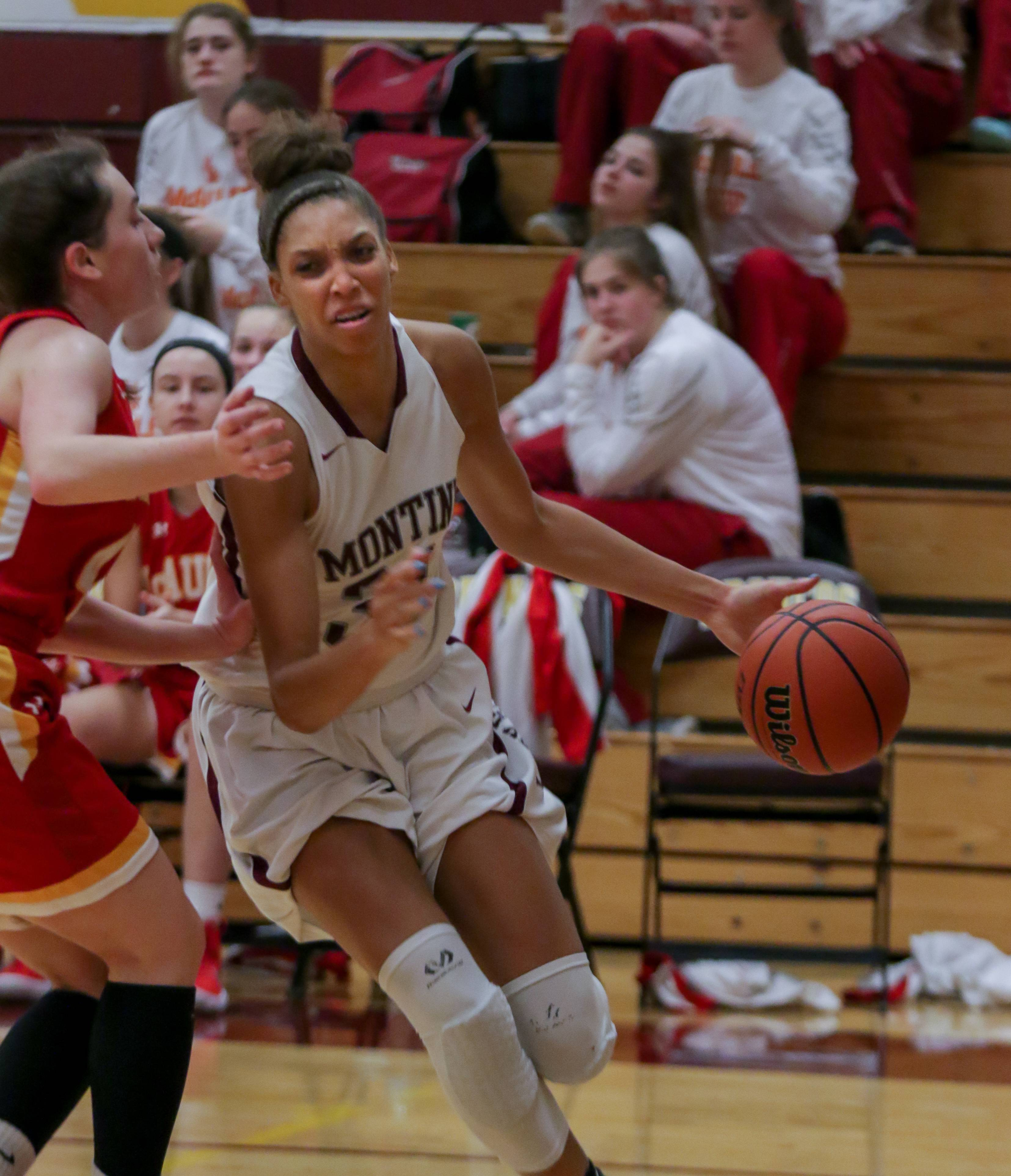 Montini's Aaliyah Patty in action against Mother McAuley in Lombard.