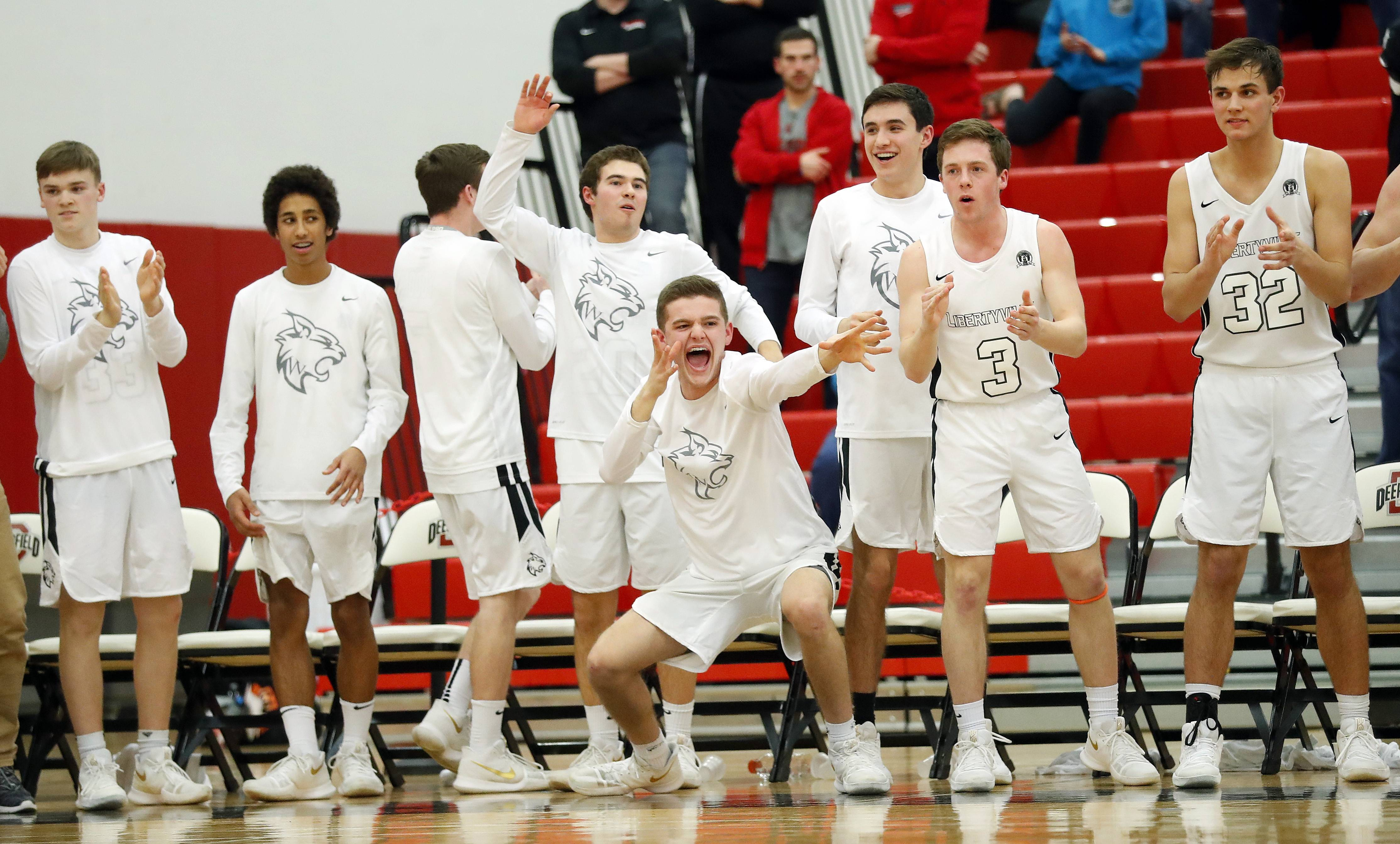 The Libertyville bench celebrates during the Wildcats' 59-56 win over Conant in Class 4A regional final play Friday at Deerfield.