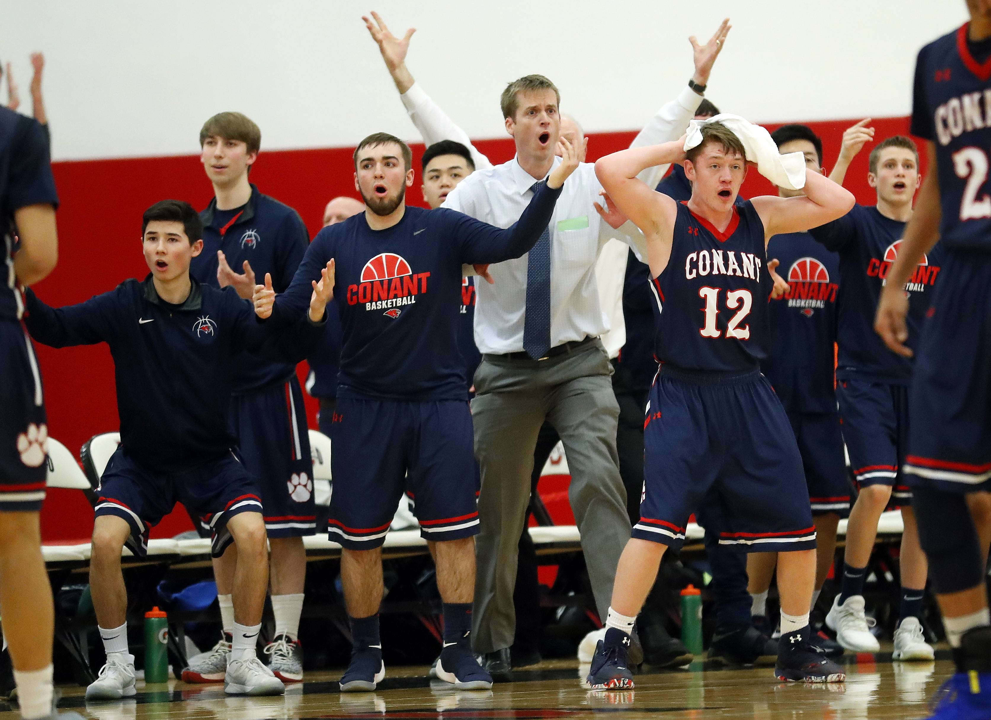 The Conant bench reacts after thinking it had gotten off a shot in time at the end of the first half during Class 4A regional final play Friday at Deerfield.