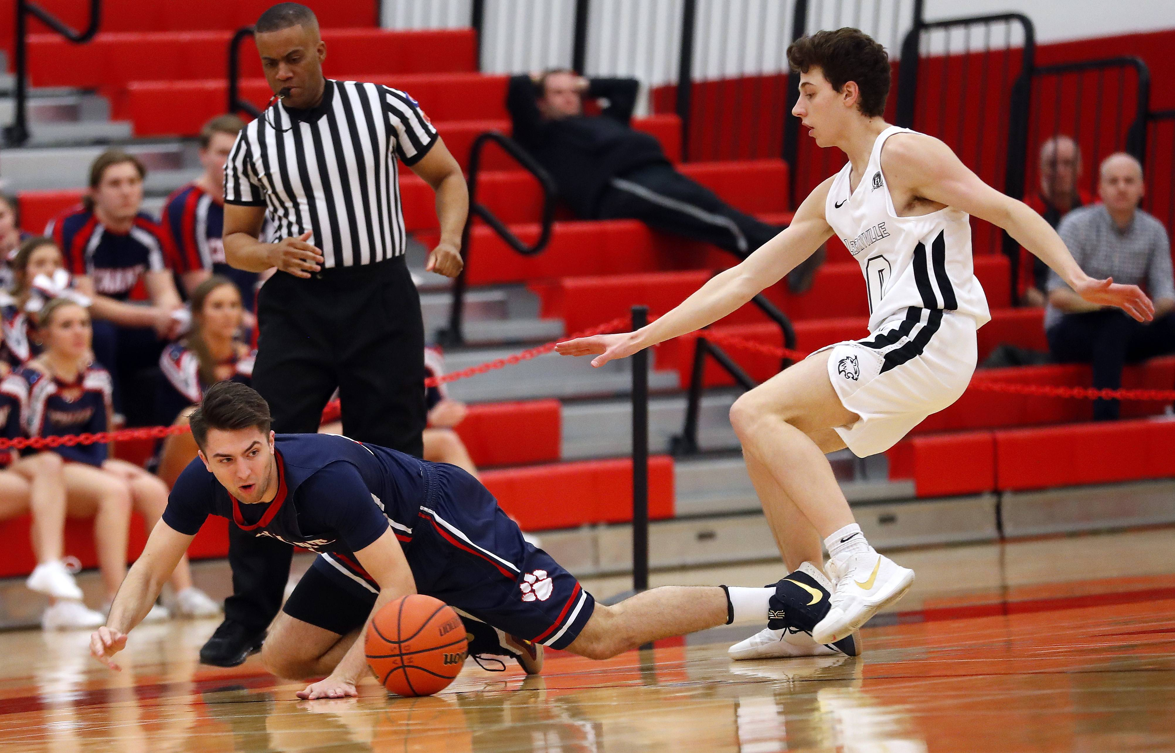 Conant's Ben Schols, left, and Libertyville's Josh Lilja scramble for a loose ball during Class 4A regional final play Friday at Deerfield.