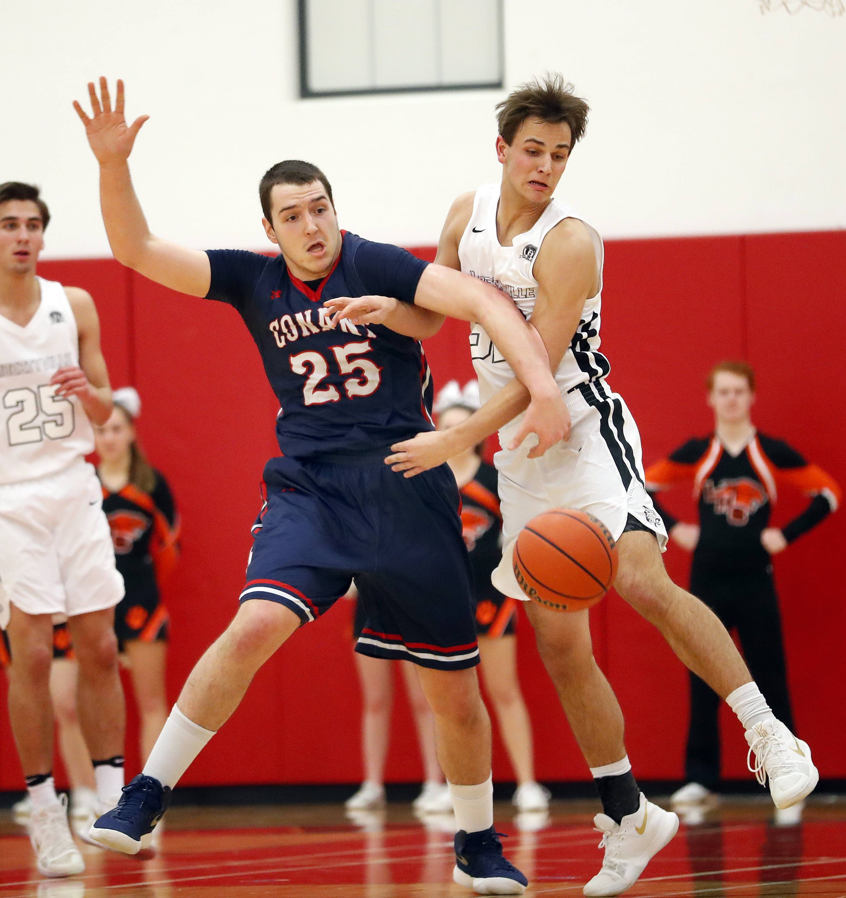 Conant's Ryan Davis (25) and Libertyville's Travis Clark battle for a rebound during Class 4A regional final play Friday at Deerfield.