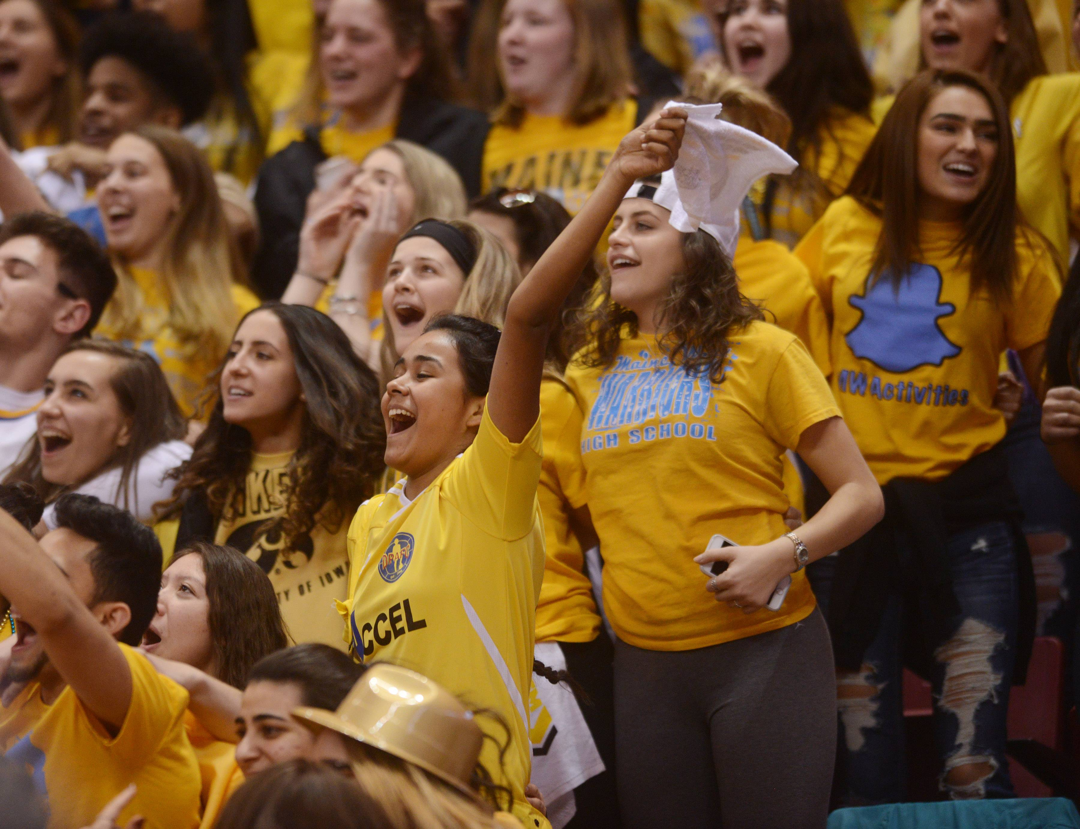 Maine West fans cheer for their team during the Class 4A girls basketball semifinal against Geneva at Redbird Arena in Normal Friday.