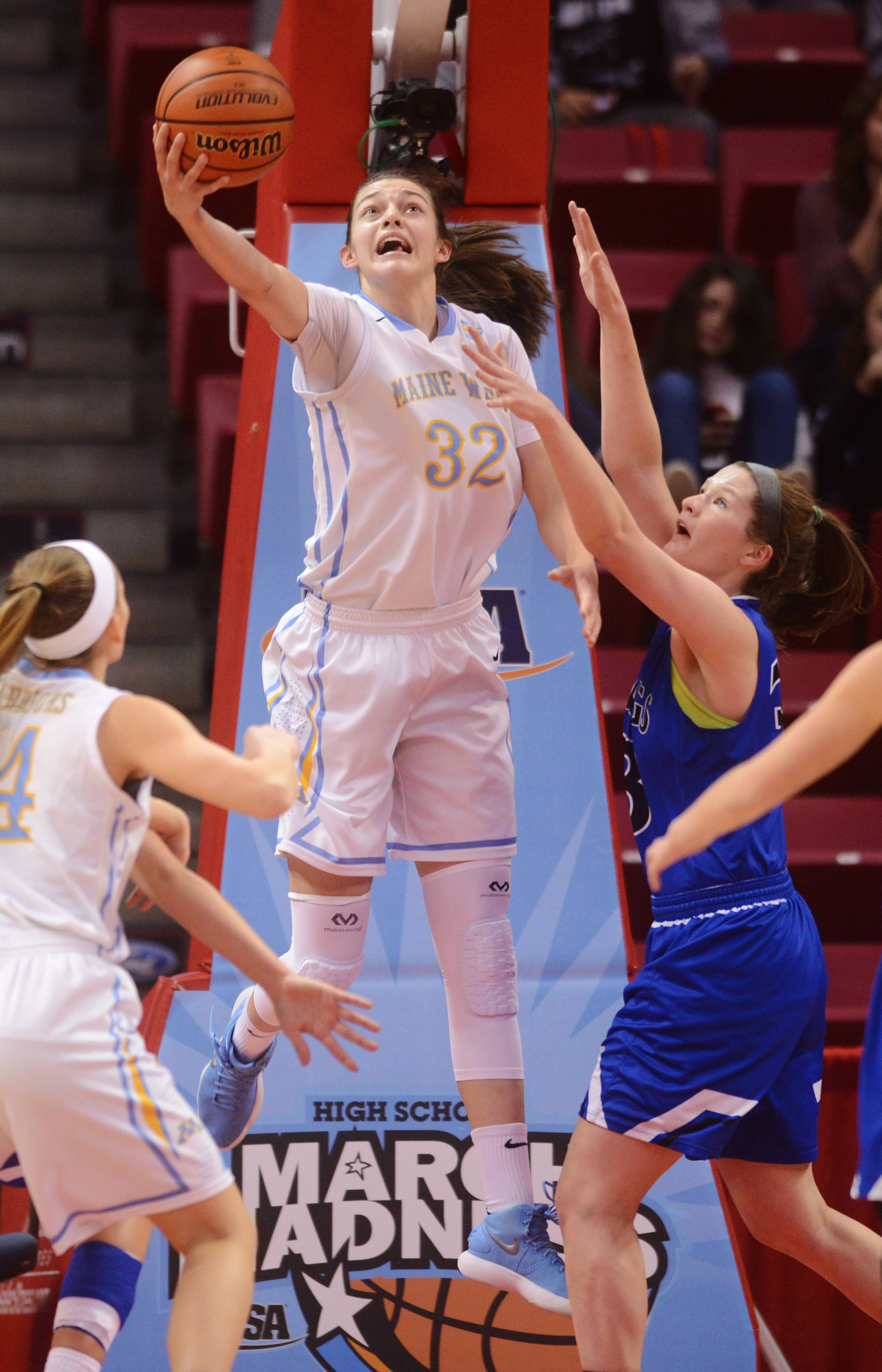 Maine West's Angela Dugalic makes a reverse layup while being guarded by Geneva's Madison Mallory during the Class 4A girls basketball semifinals at Redbird Arena in Normal Friday.