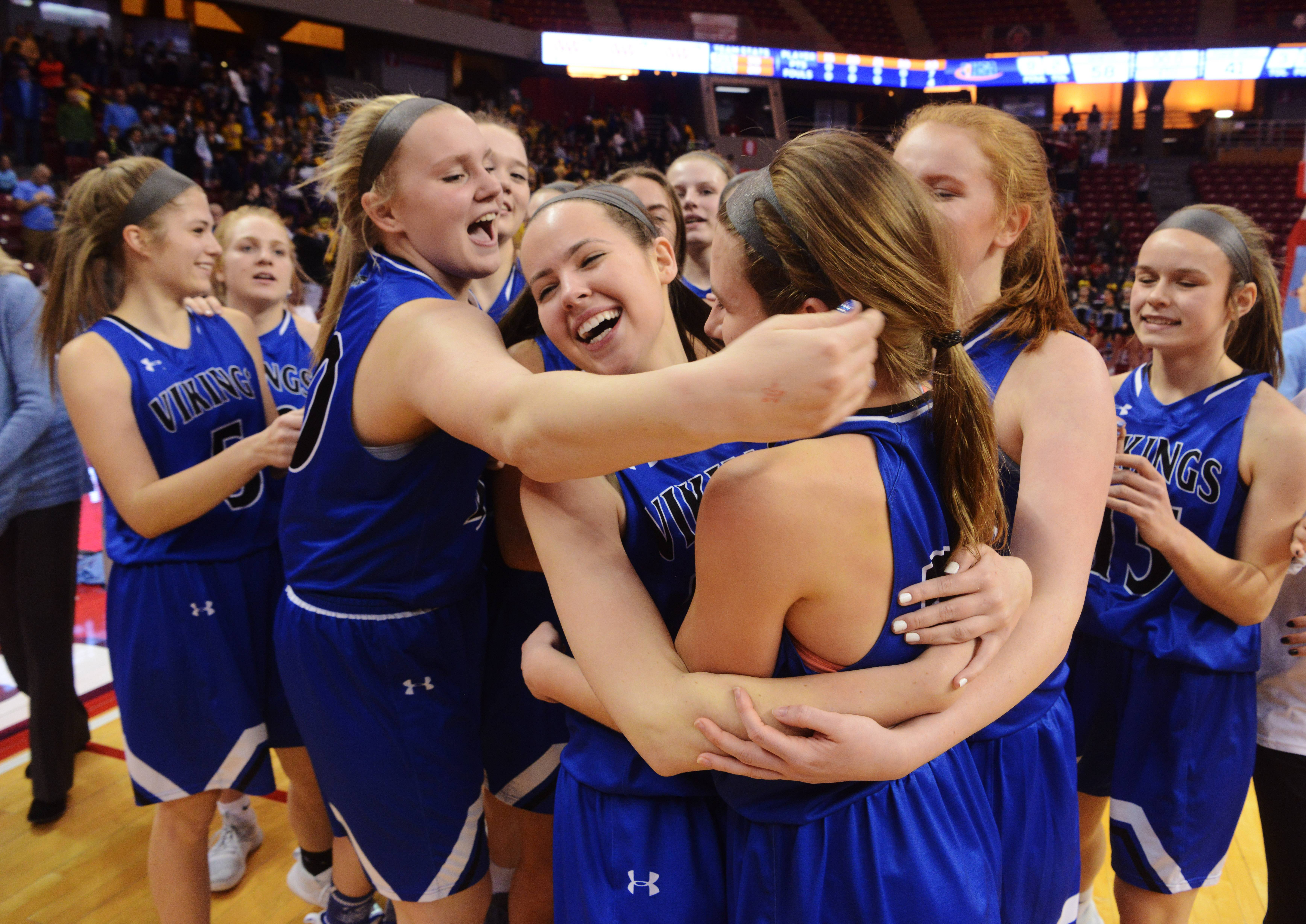 Geneva players celebrate their 58-41 victory over Maine West during the Class 4A girls basketball semifinal at Redbird Arena in Normal Friday.