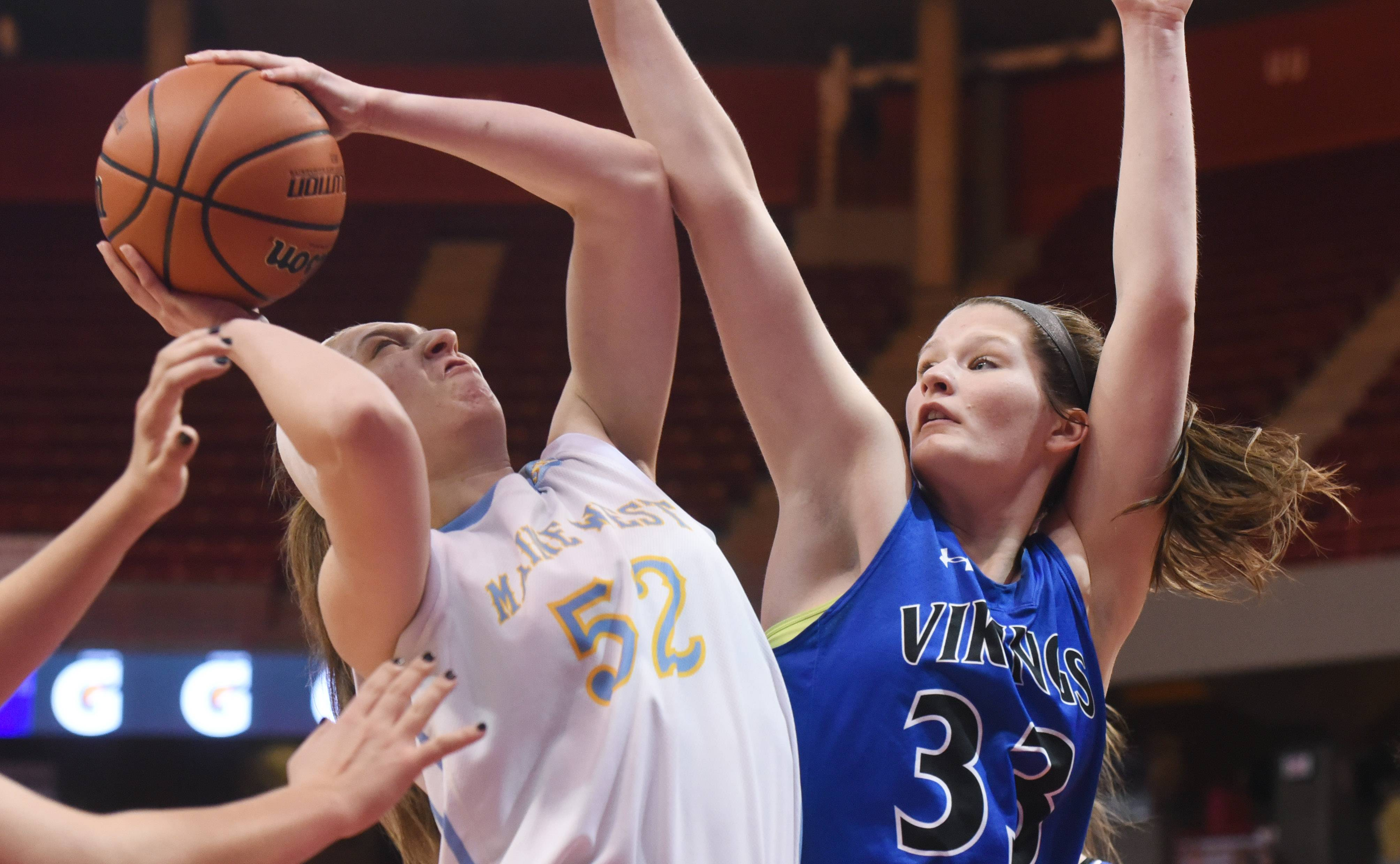 Maine West's Jessica Riedl, left, battles under the basket with Geneva's Madison Mallory during the Class 4A girls basketball semifinals at Redbird Arena in Normal Friday.