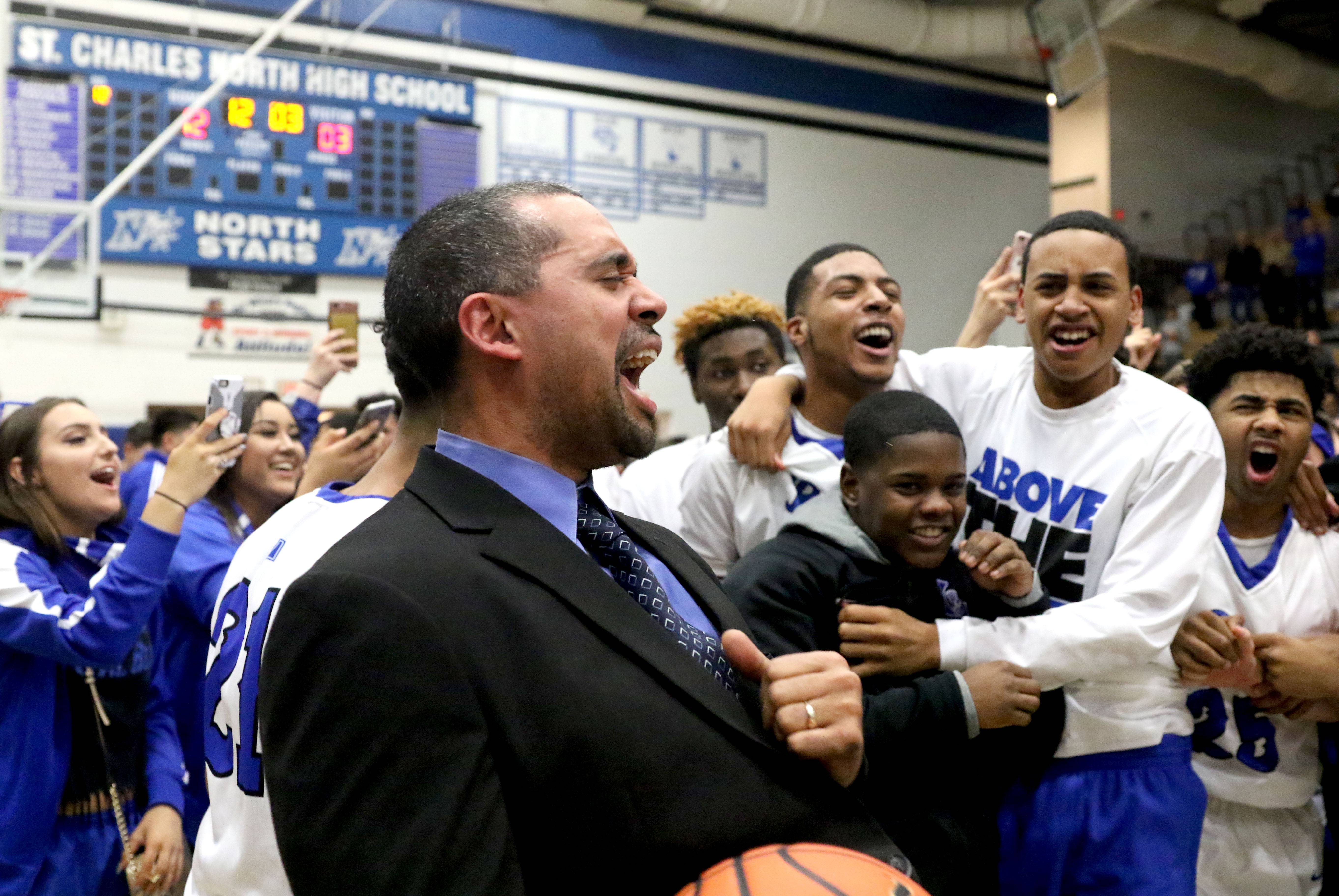 The Royals of Larkin High School celebrate a Class 4A regional championship win over St. Charles North at St. Charles North Friday night. Larkin head coach Deryn Carter gets his team revved up after the win.
