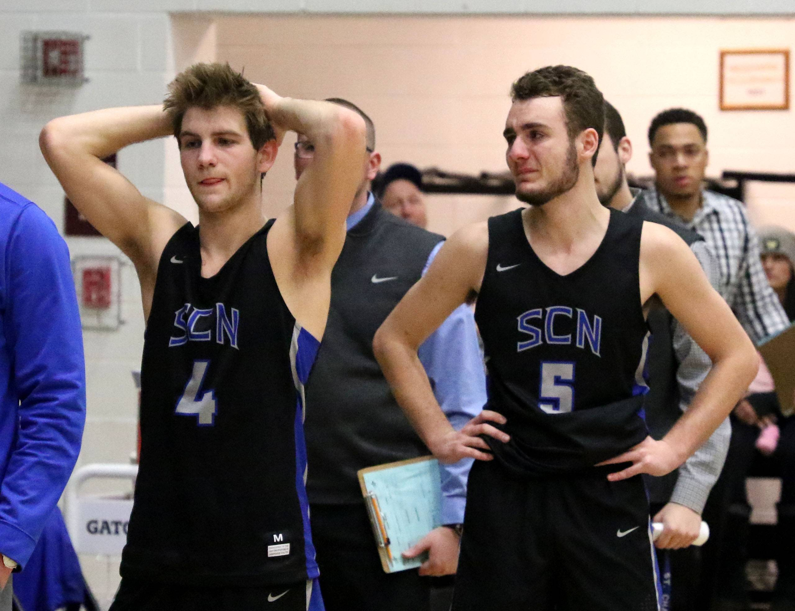The North Stars fell to Larkin High School in a Class 4A regional championship game at St. Charles North Friday night. Zachary Ludwig, left, and Brendan Dal Degan react after the final buzzer sounds.