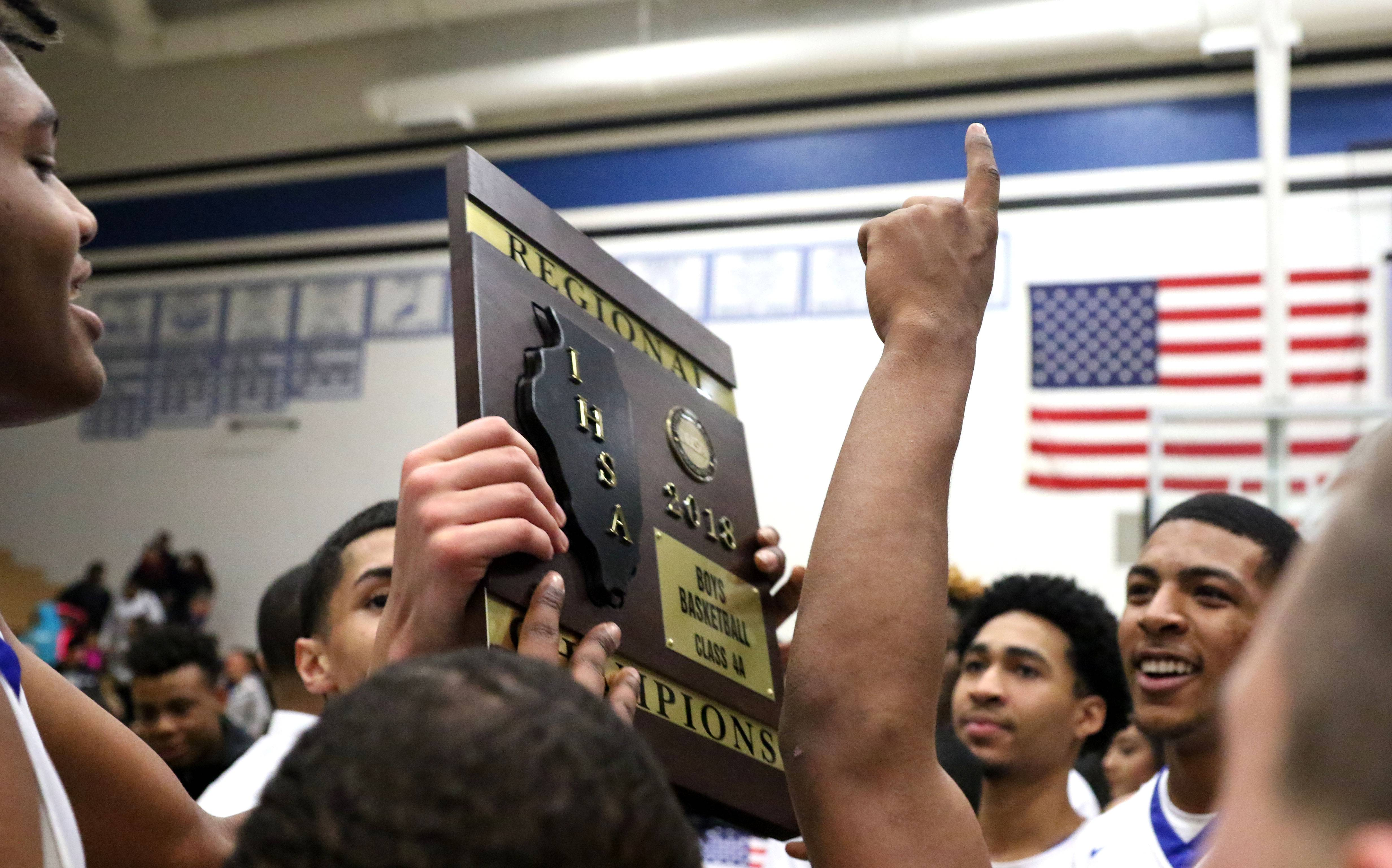 Jalen Shaw, far left, and the Royals of Larkin High School celebrate a Class 4A regional championship win over St. Charles North at St. Charles North Friday night.