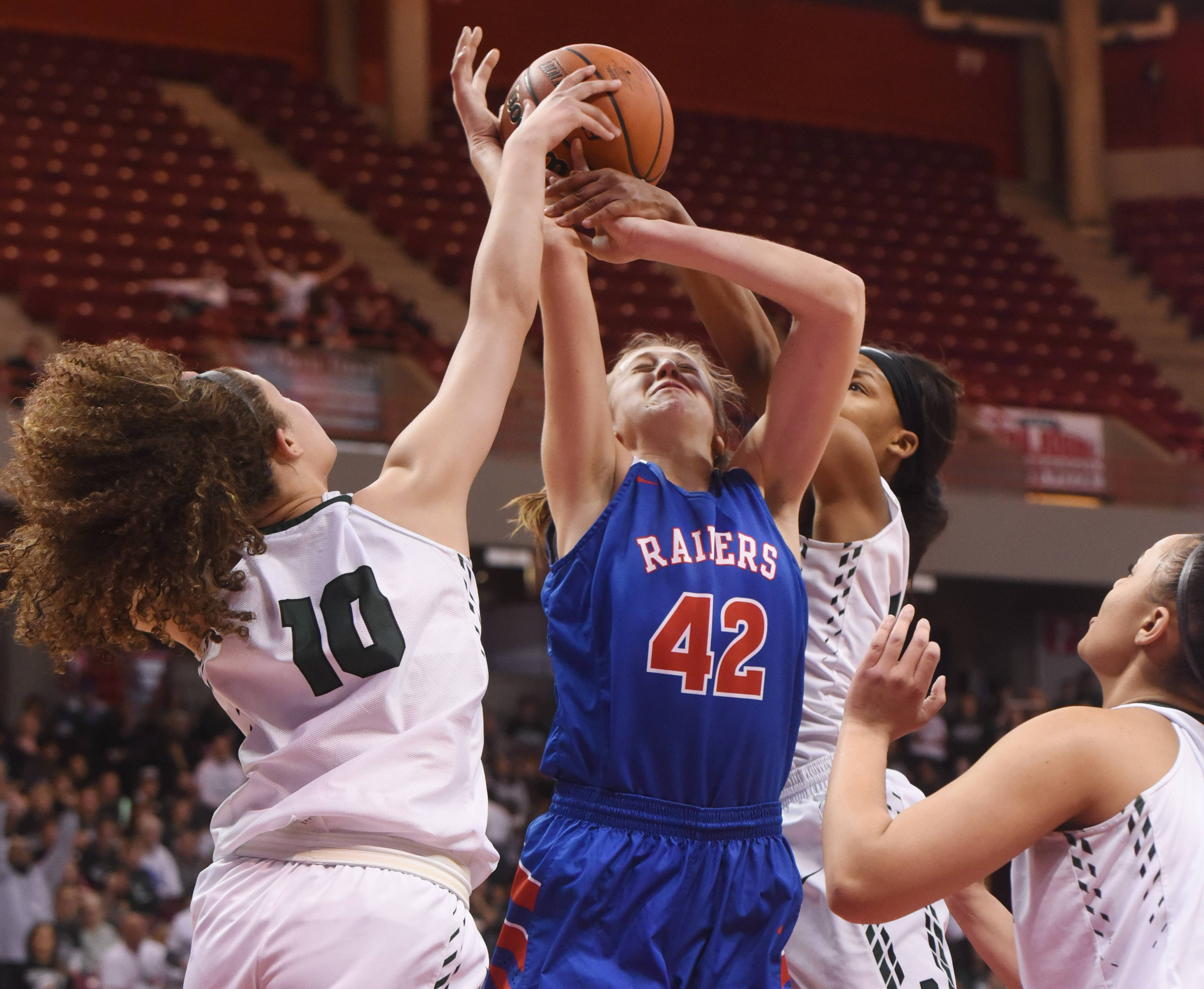 Glenbard South's Maggie Bair draws contact as she encounters Peoria Richwoods' Tianna Johnson, left, Kourtney Crane and Mariah Hopson, right, under the basket during the Class 3A girls basketball semifinal at Redbird Arena in Normal Friday.
