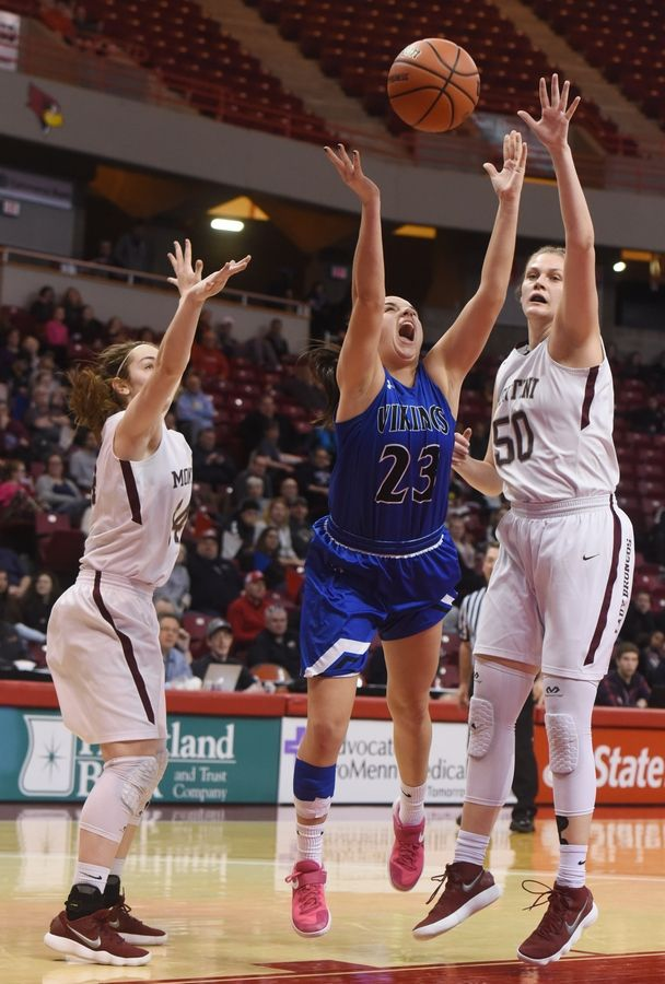 Joe Lewnard/jlewnard@dailyherald.comGeneva's Margaret Whitley attempts a shot between Montini's Francesca Kokkines, left, and Lindsey Jarosinski during the girls basketball Class 4A title game at Redbird Arena in Normal Saturday.