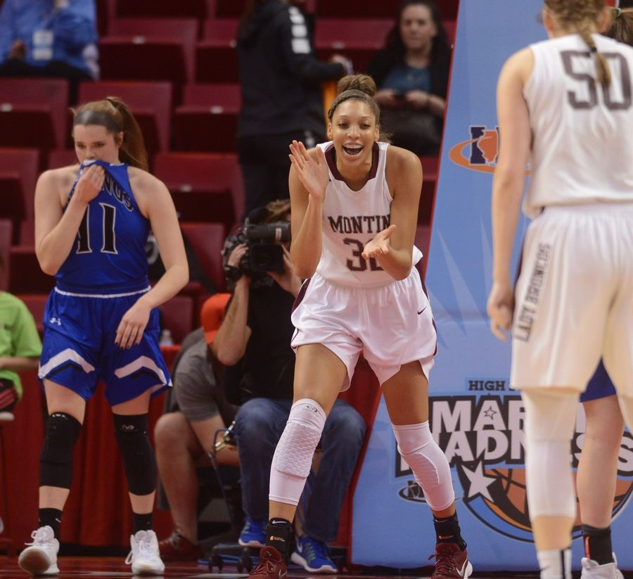 Montini's Aaliyah Patty, middle, celebrates after getting a basket and a foul during the girls basketball Class 4A title game against Geneva at Redbird Arena in Normal Saturday.